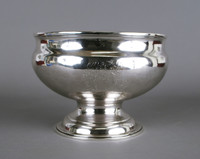 Very simple footed silver bowl of bulbous form, slightly concave at shoulder with on one side the (later) engraved coat-of-arms, probably of the McIntyre and/or Evans families.