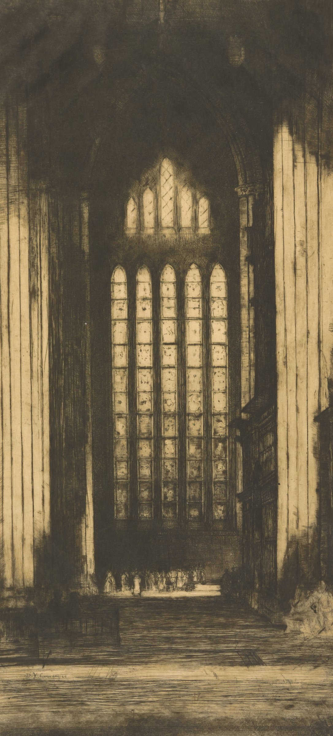 View of a cathedral window in York Minster Cathedral. People gather underneath the window.