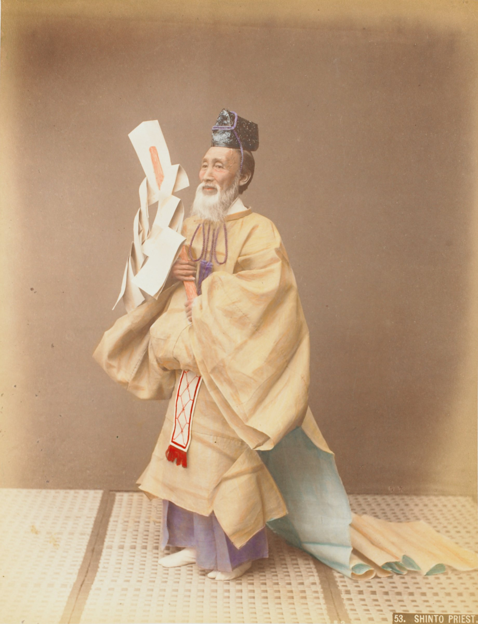 Winter Costume (.4, recto); Shinto Priest (.5, verso), Attributed to Kusakabe Kimbei, hand-colored albumen prints mounted to album page