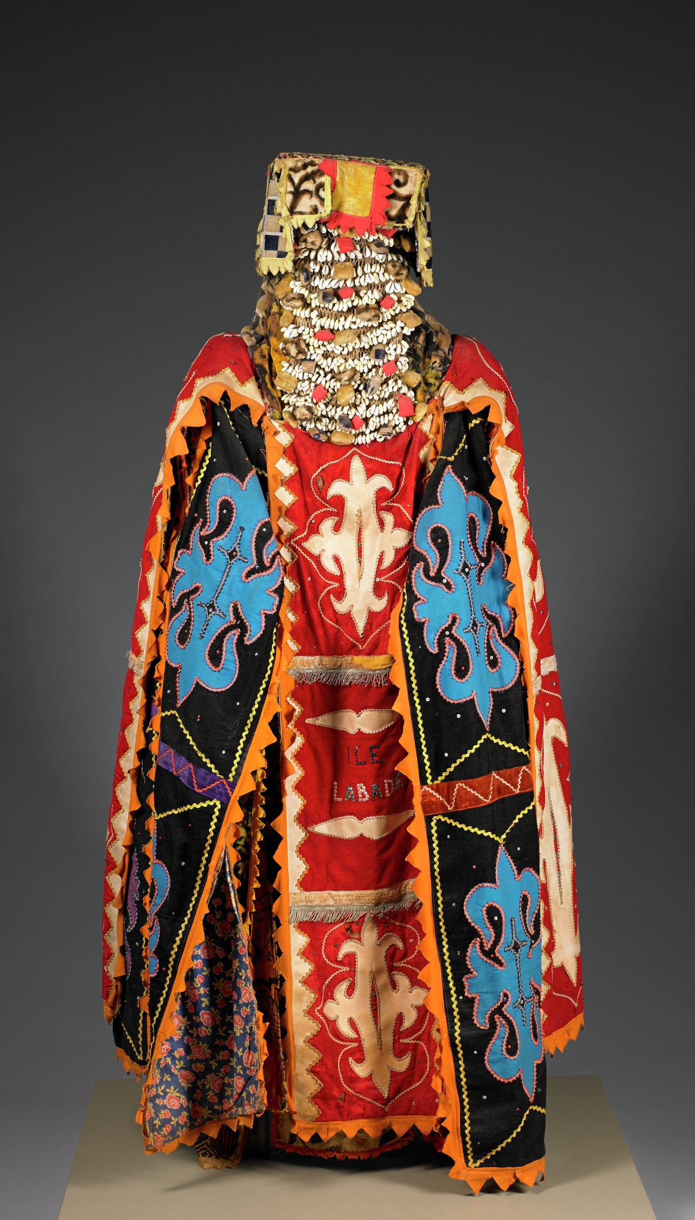 Costume for Egungun Masquerade, Yoruba people, Republic of Benin (formerly Kingdom of Dahomey), African, cotton cloth, corduroy, sequins, rickrack, Asian rug fragment, cowrie shells, amulets