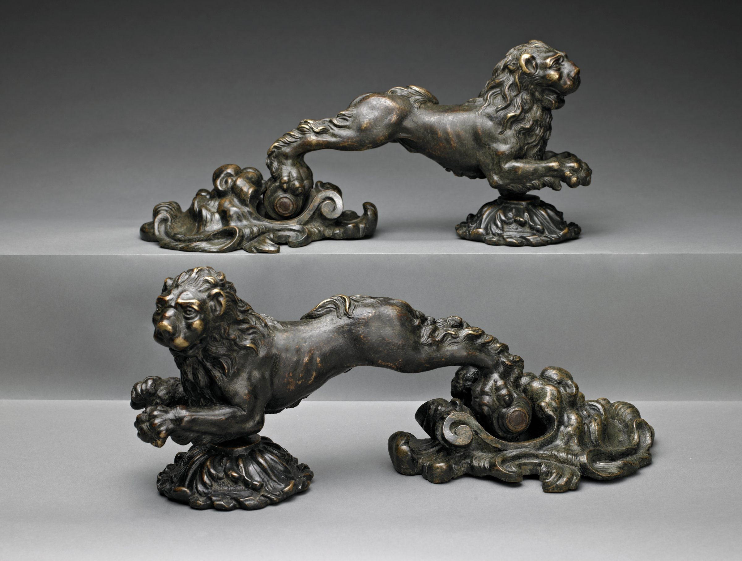 Cast and chased bronze door knockers in the form of lions
