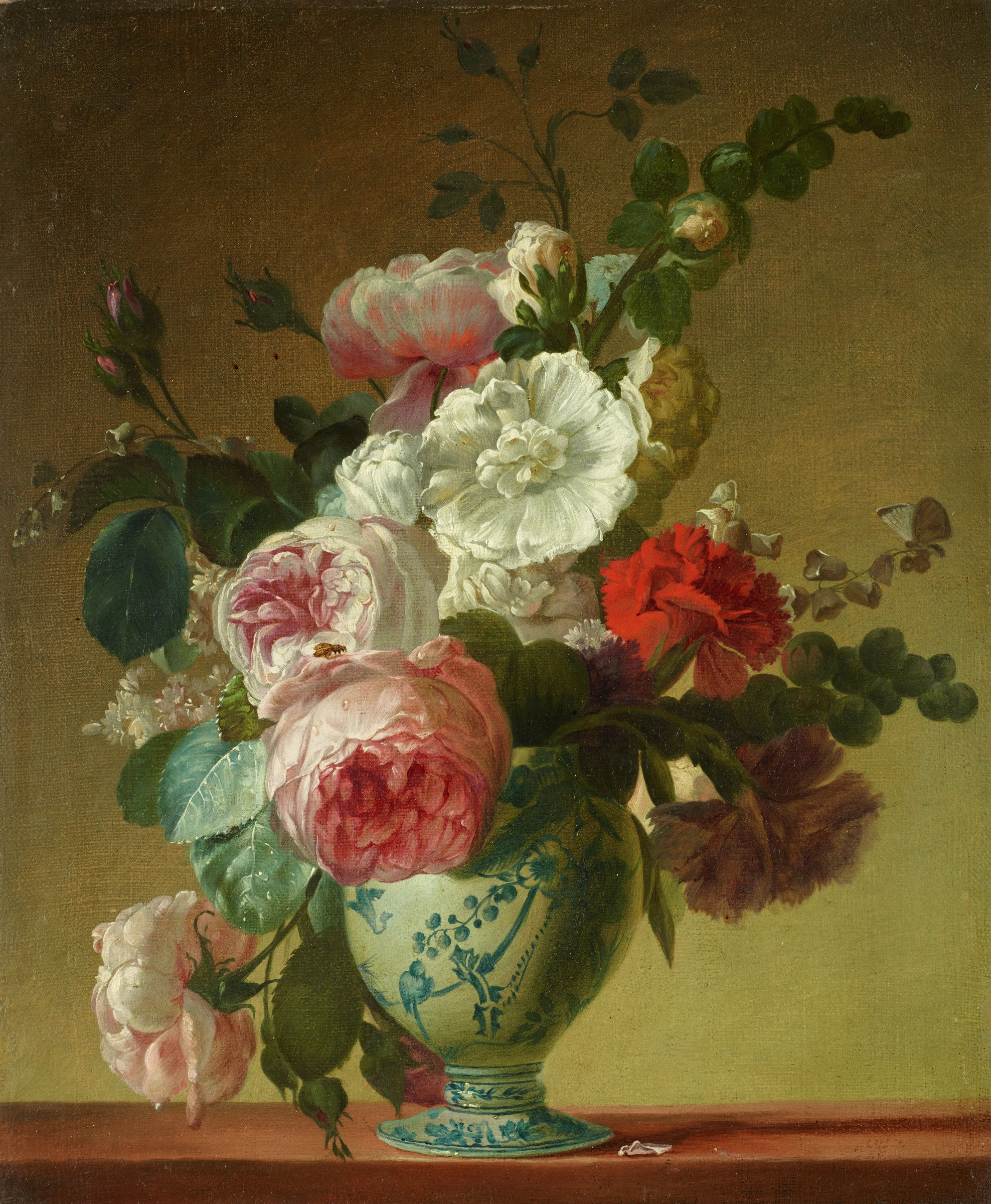 Still life with a bouquet of roses, carnations, hollyhocks, lilacs and other flowers in a blue Delft vase, in contemporary carved and gilded wood frame.