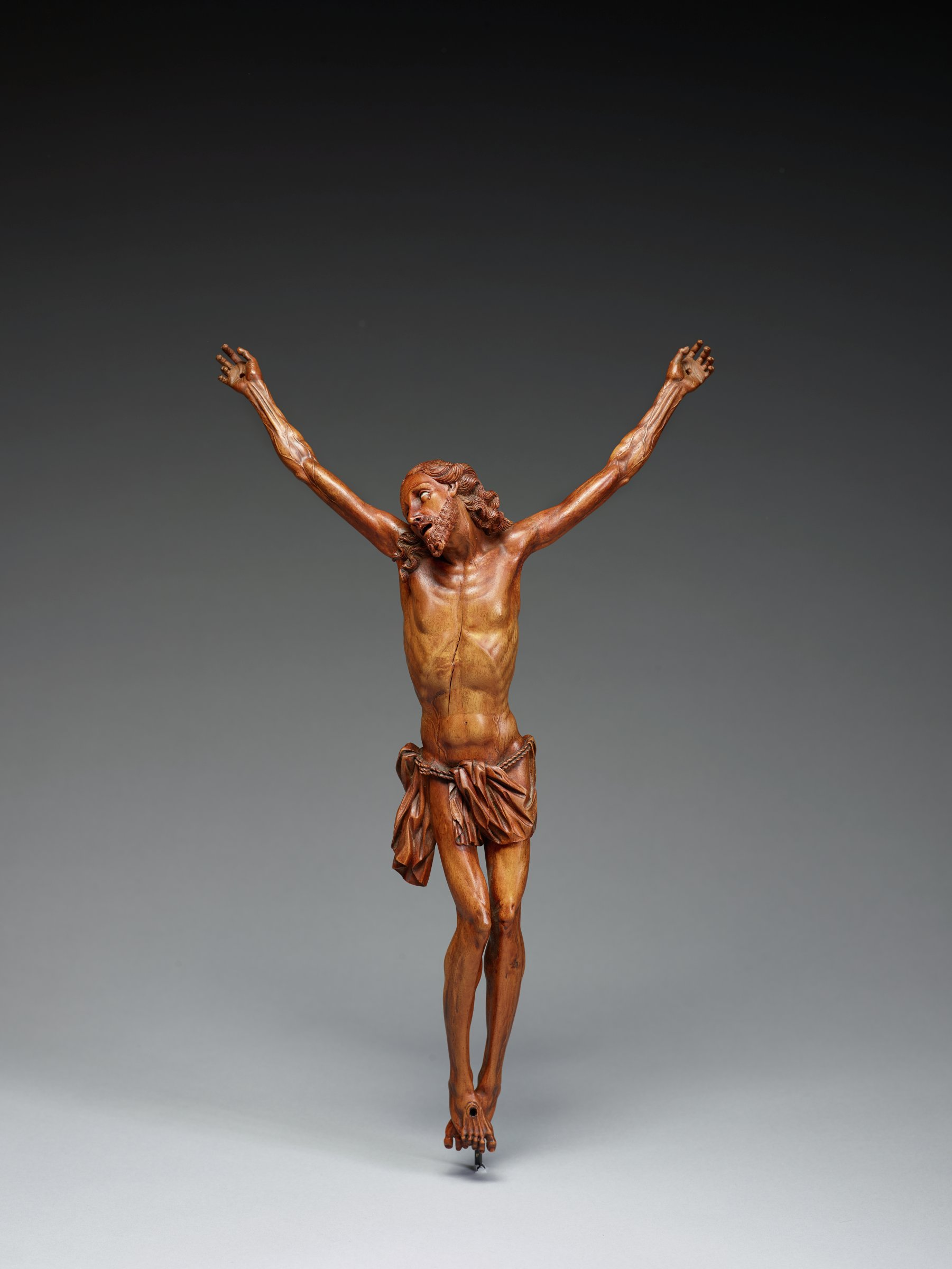 The Figure of Christ on the cross with his head turned sideways looking up.