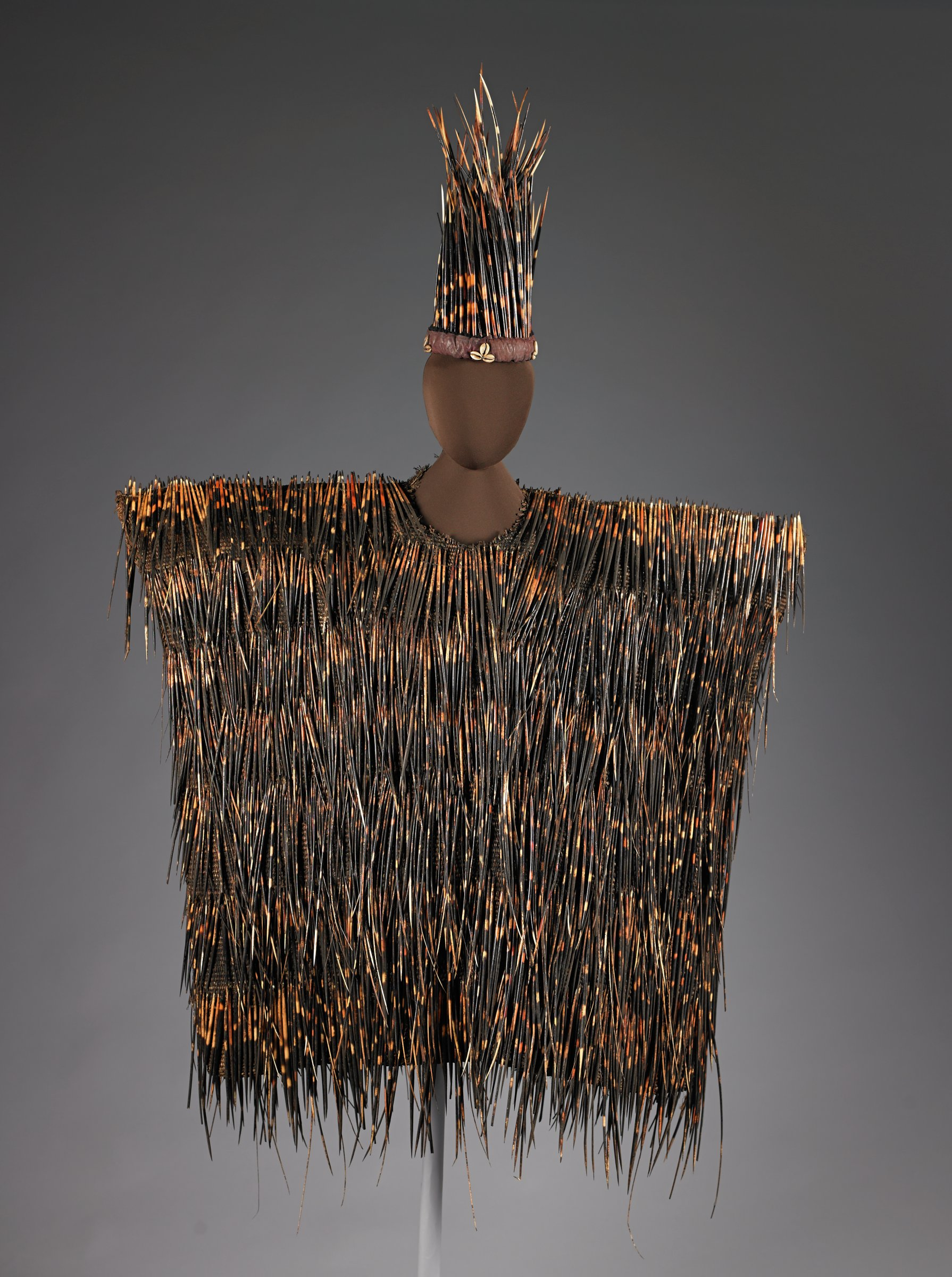 Woven plant fiber tunic with attached porcupine quills.