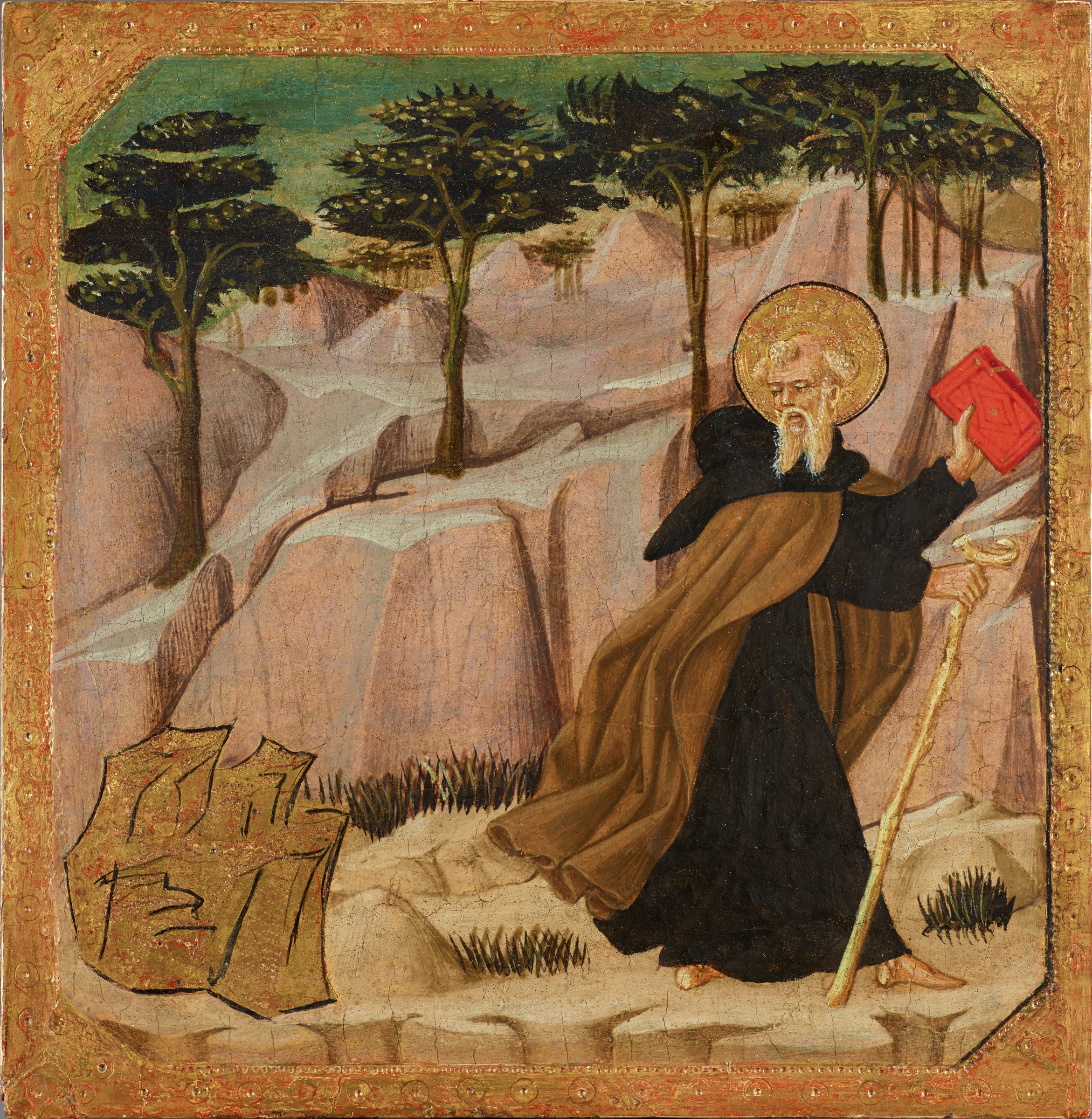 Saint Anthony Abbott comes upon a large piece of gold on his walk through a rocky landscape. He looks at it while trying to pull himself away.