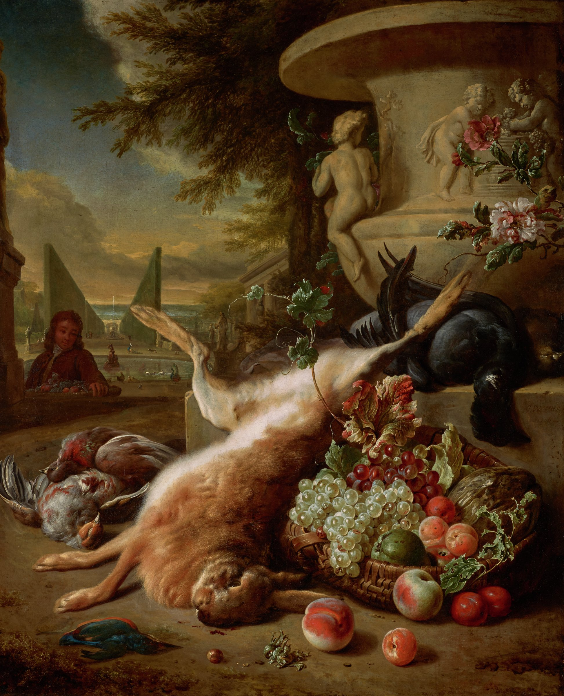 A dead hare is draped over a ledge in an outdoor garden setting, surrounded by a goose, two partridges, and a kingfisher. The bird on the ledge on the far right not identified. A melon, grapes, peach, apricot, and plums are lying in a basket to the right of the hare. Two peaches and three plums have fallen out of the basket. In the foreground are two hazelnuts. The upper right is dominated by a large garden vase. A vista into a garden setting with ponds and a fountain, tall hedges, buildings and sculptures is on the left. A young male figure is shown bust length behind a drop in the terrain, carrying a basket with fruit, and looking towards the viewer.