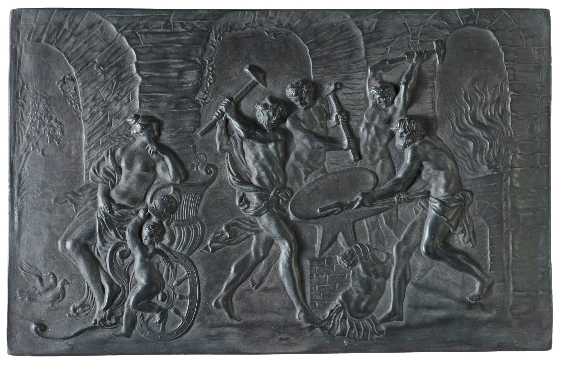 Small, slightly irregular rectangular tablet with the bas relief image of Vulcan forging the armor for Achilles, in the center stands Vulcan swinging his hammer while another holds a shield on the anvil, in the background are two other figures swinging their hammers, at Vulcan's feet lies part of a suit of armor and on the left sits Venus in Achilles's chariot, classically draped, her body turned toward Vulcan and her left hand brought to her chin, at her feet stands a small, winged Cupid holding Achilles's helmet aloft in his two hands, in the background is the fiery forge on the right and a landscape visible through the brick arches in the center and left; the surface has a slight bronze patina.
