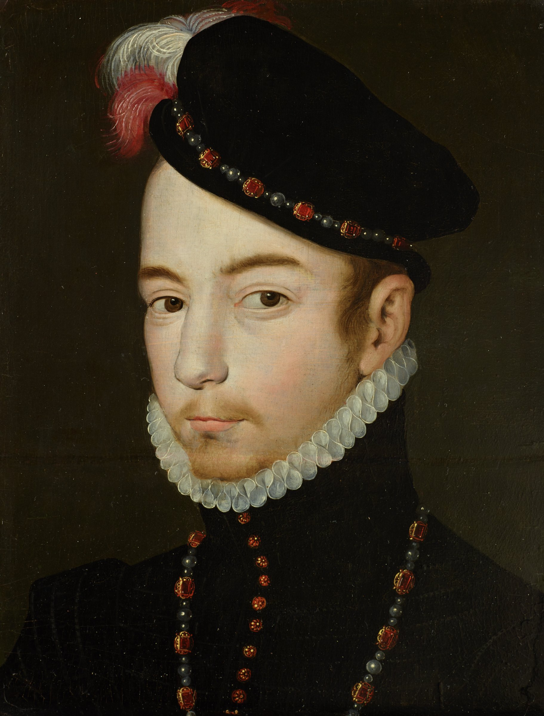 The painting is a portrait of a young man shown slightly less than in bust-length. His head is turned slightly sideways, but he is looking directly at the viewer. He is wearing black dress with a high color with white lace trim and a black hat decorated with feathers and jewelry. His garment is buttoned with red, precious stones and he is wearing a a jewelled necklace.