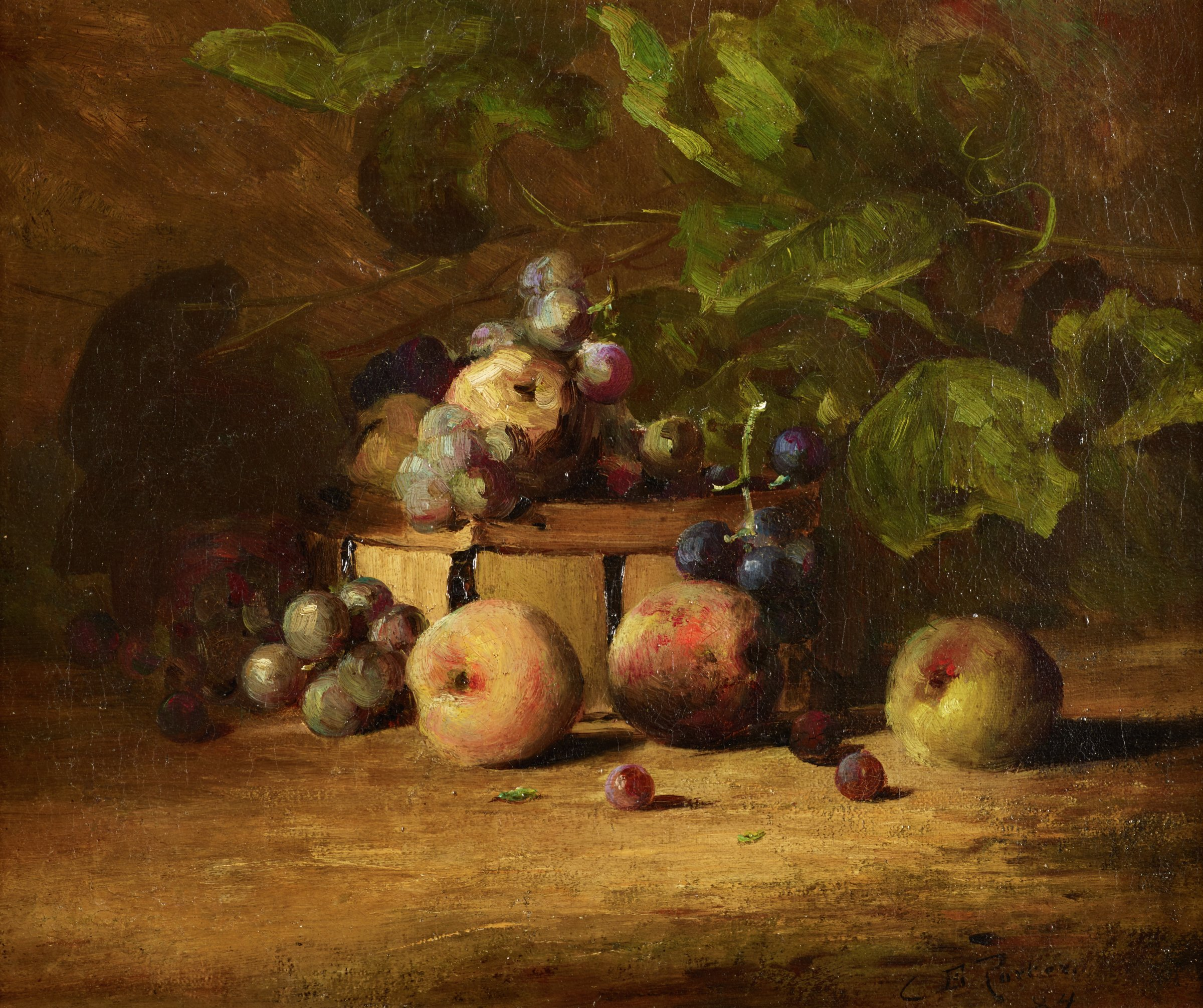 A basket sits in darkness on the ground. Green leaes loom over it, and inside are purple grapes and what appears to be an upside-down pear. In front of the basket are more purple grapes, two peaches, and a green apple.