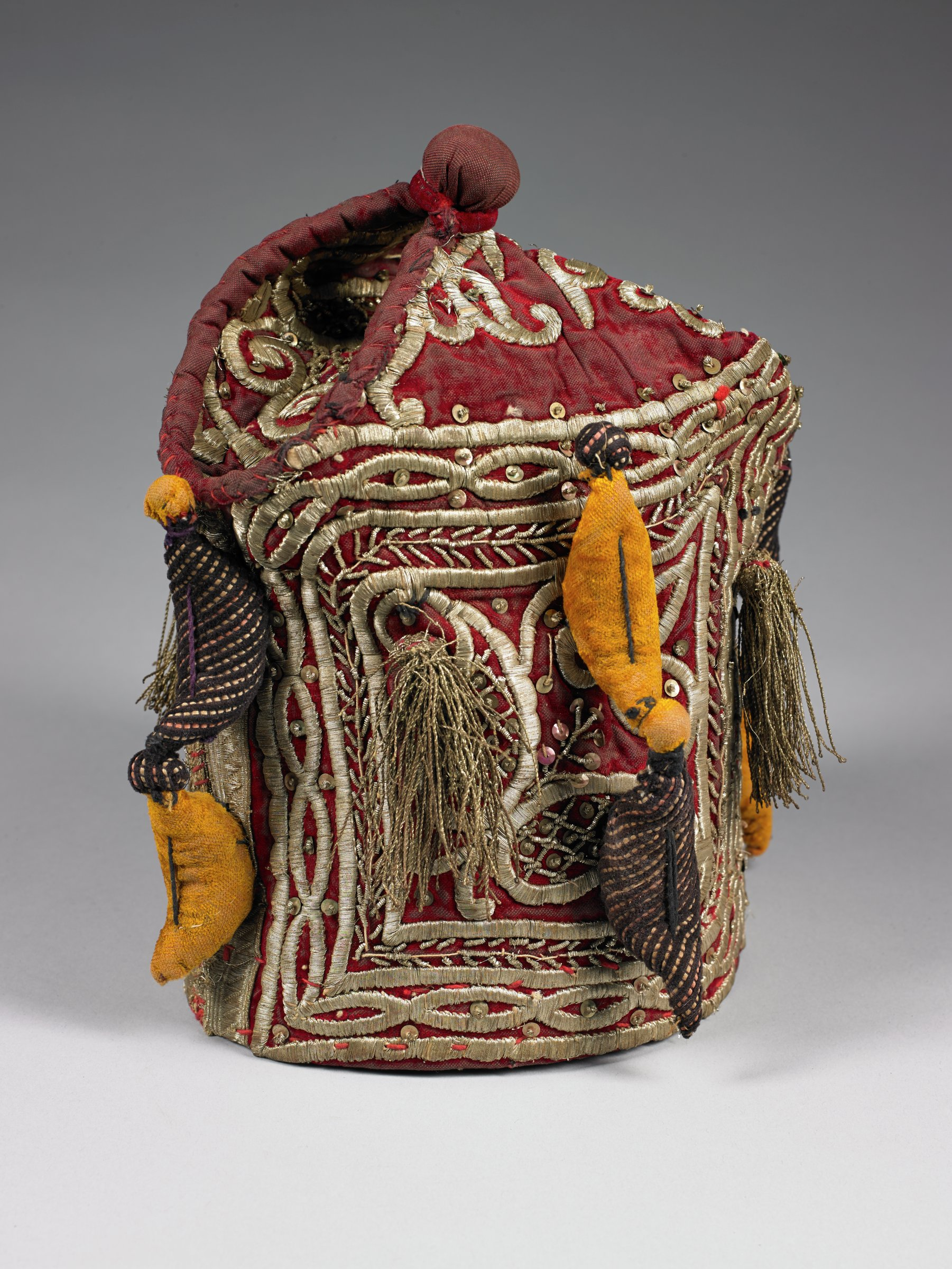 """This """"undress"""" crown is a type of headgear worn by a Yoruba king on festive or ceremonial occasions that do not warrant the wearing of the most important veiled and beaded crown"""