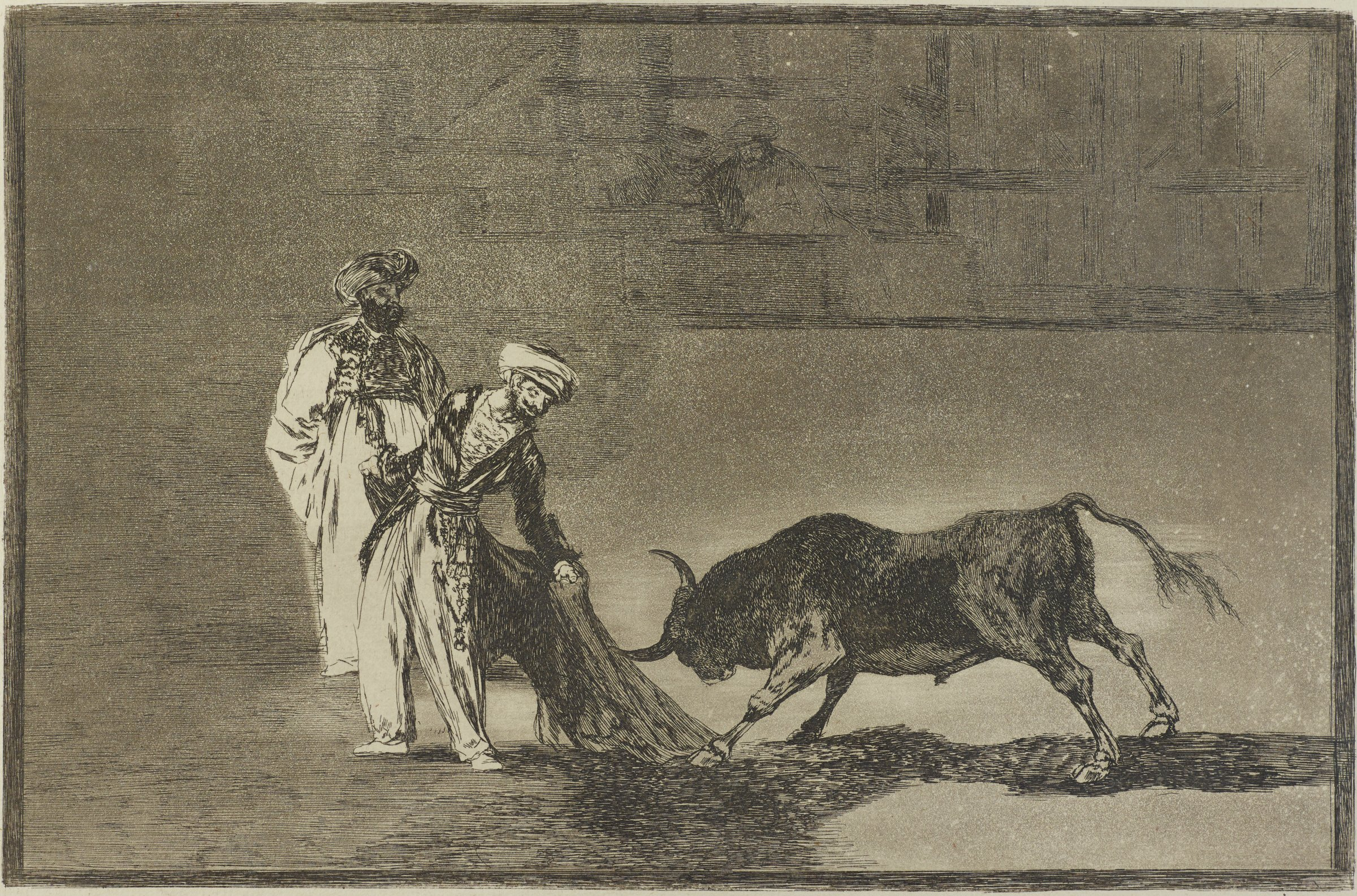 Plate 6 of the Tauromaquia. A man with a cape stands antagonizing a bull that is charging towards the cape. Another larger man stands behind the first. Half drawn In the background are seated men in a crowd.