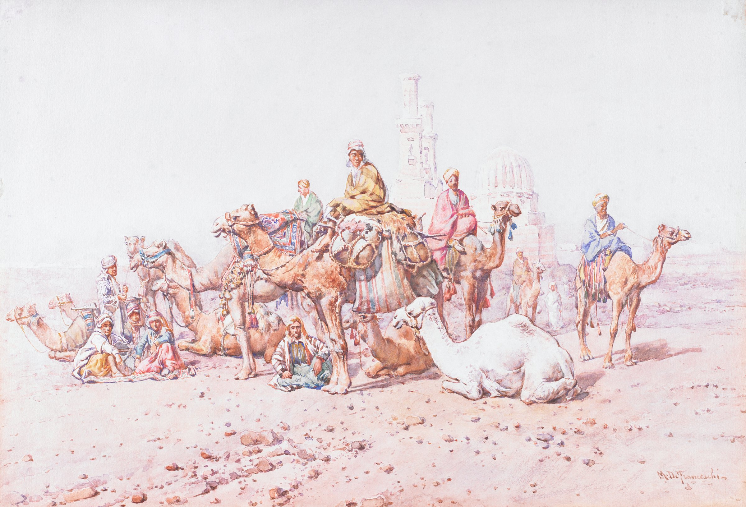 In foreground: rocky soil. In middle ground: approximately eleven camels, with people, standing and resting on ground, with an architectural structure directly behind.