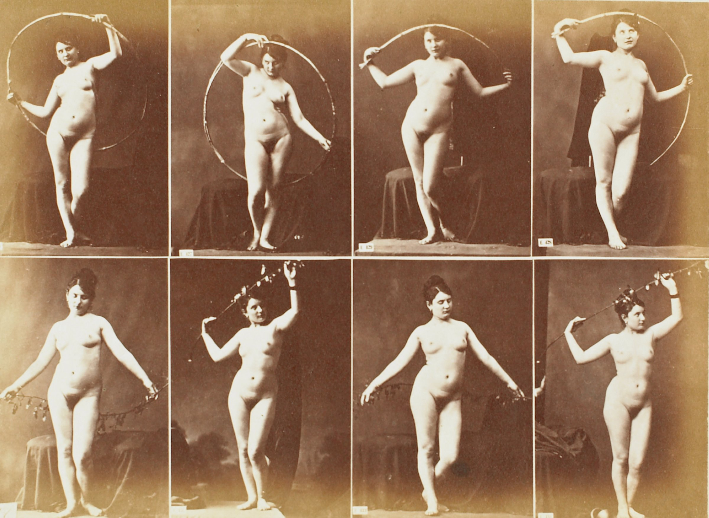 """Albumen print with eight images of a nude woman in varied poses mounted onto blue paper with printed text """"A.CALAVAS Éditeur, — 68, Rue de Lafayette, PARIS."""" Paper is mounted to 2-ply non-acidic mat board. Appears to have been removed from a book binding."""