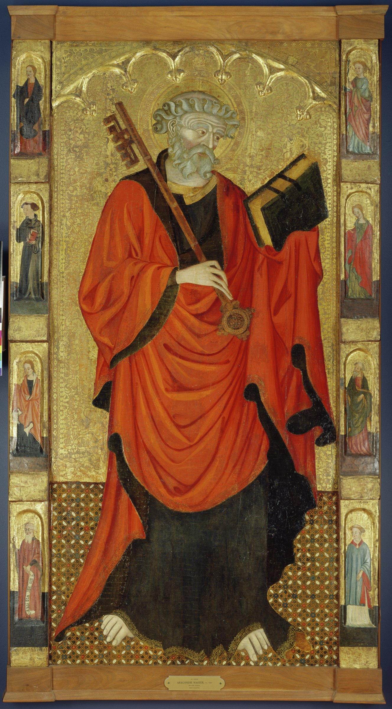 Saint Peter stands in the center of the panel, holding a large key and book. He is framed on the right and left by saints depicted in miniature.