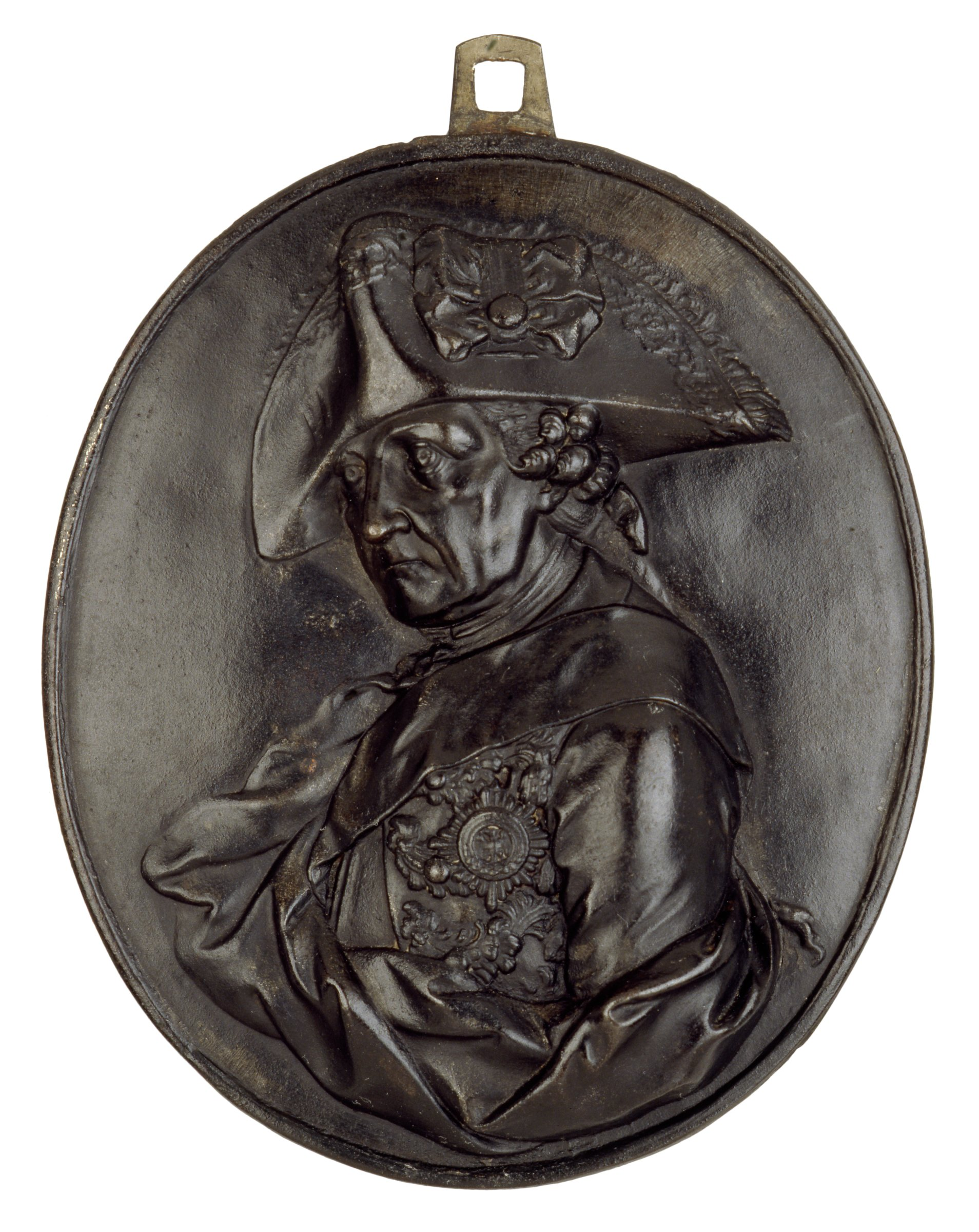 Bust in profile left, head turned front, in uniform with sash and medals, and drapery.