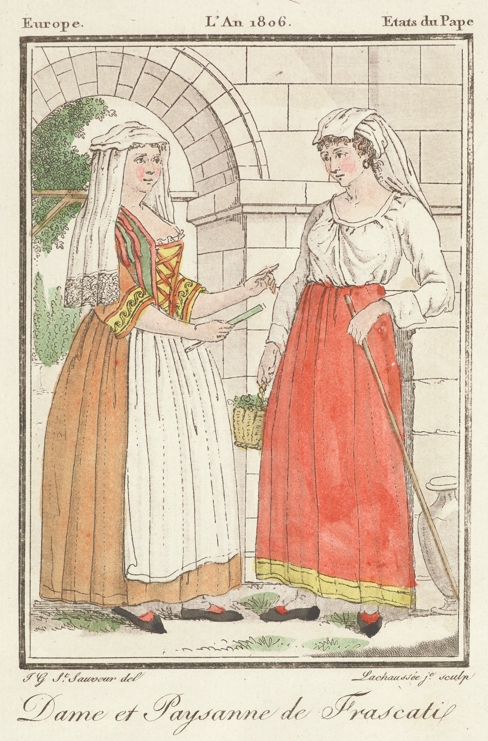 Two women stand infront of a stone arched structure. The woman on the left wears an elagent dress with a white headress that falls around her shoulders. The woman on the right wears a simple shirt and skirt with a white headress that falls down her back.