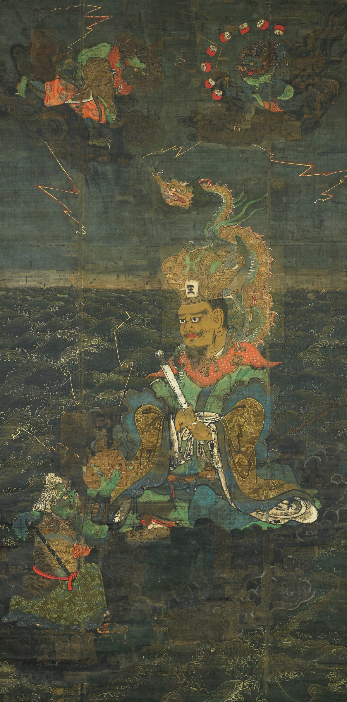 """Central figure in Chinese attire with the character """"wang"""" meaning King on his crown. Dragon perched on his shoulders seated on cloud amidst waves as lightening crackles around him.; surrounding him are three onies, two in the air representing wind and thunder, another kneeling before the king offering a miniature mountain with bull and bird shaped mountains; mounted in gold and purple silk."""