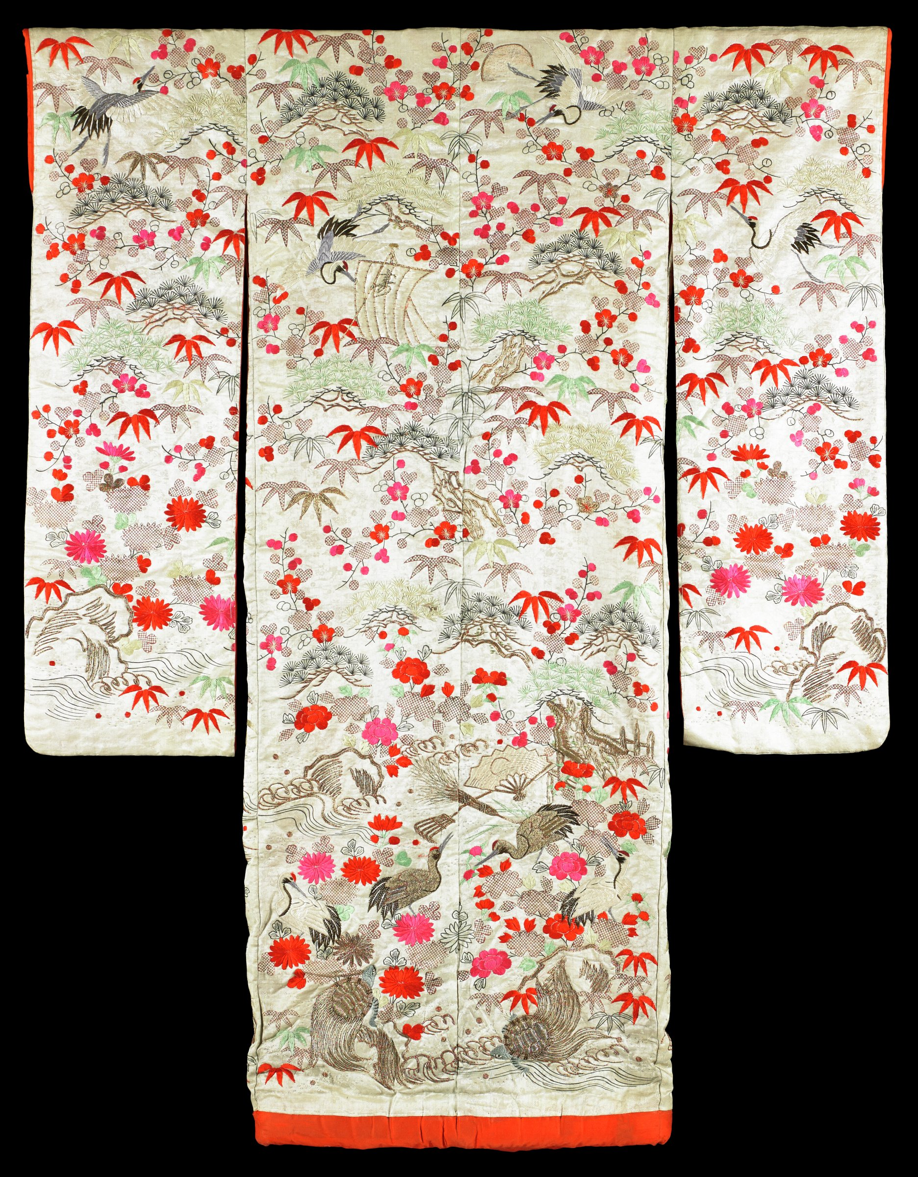 Furisode Kimono with Three Friends of Winter (Pine, Plum and Bamboo), Longevity Symbols such as Cranes, Tortoises and Emblems of the Seven Lucky Gods White silk ground, red stuffed hem, gold and silk embroidery