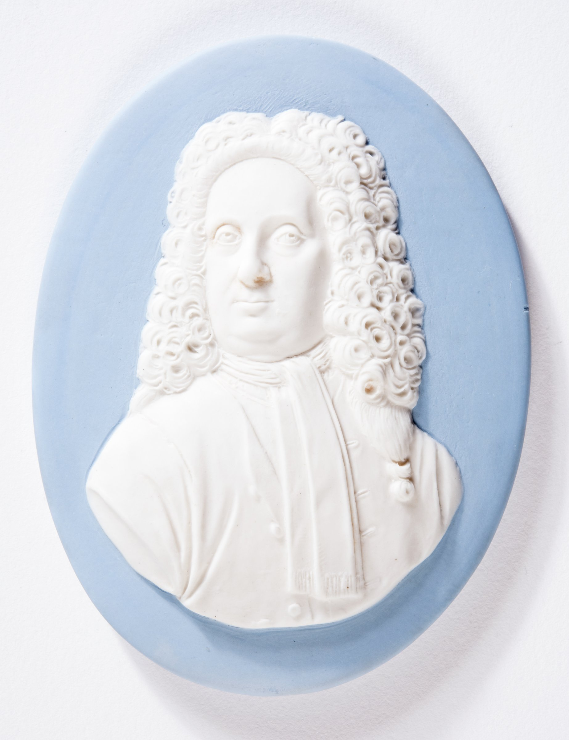 Light blue and white jasper portrait medallion depicting the potter John Philip Elers (1664-1738) slightly right with his head turned to the left, wearing a wig and neck scarf.