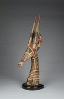 Vertical antelope headdress with straight horns and curved ears; painted with white, red, and black linear geometric patterns