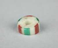 Disc-shaped glass trade bead with white, red and turquoise strips