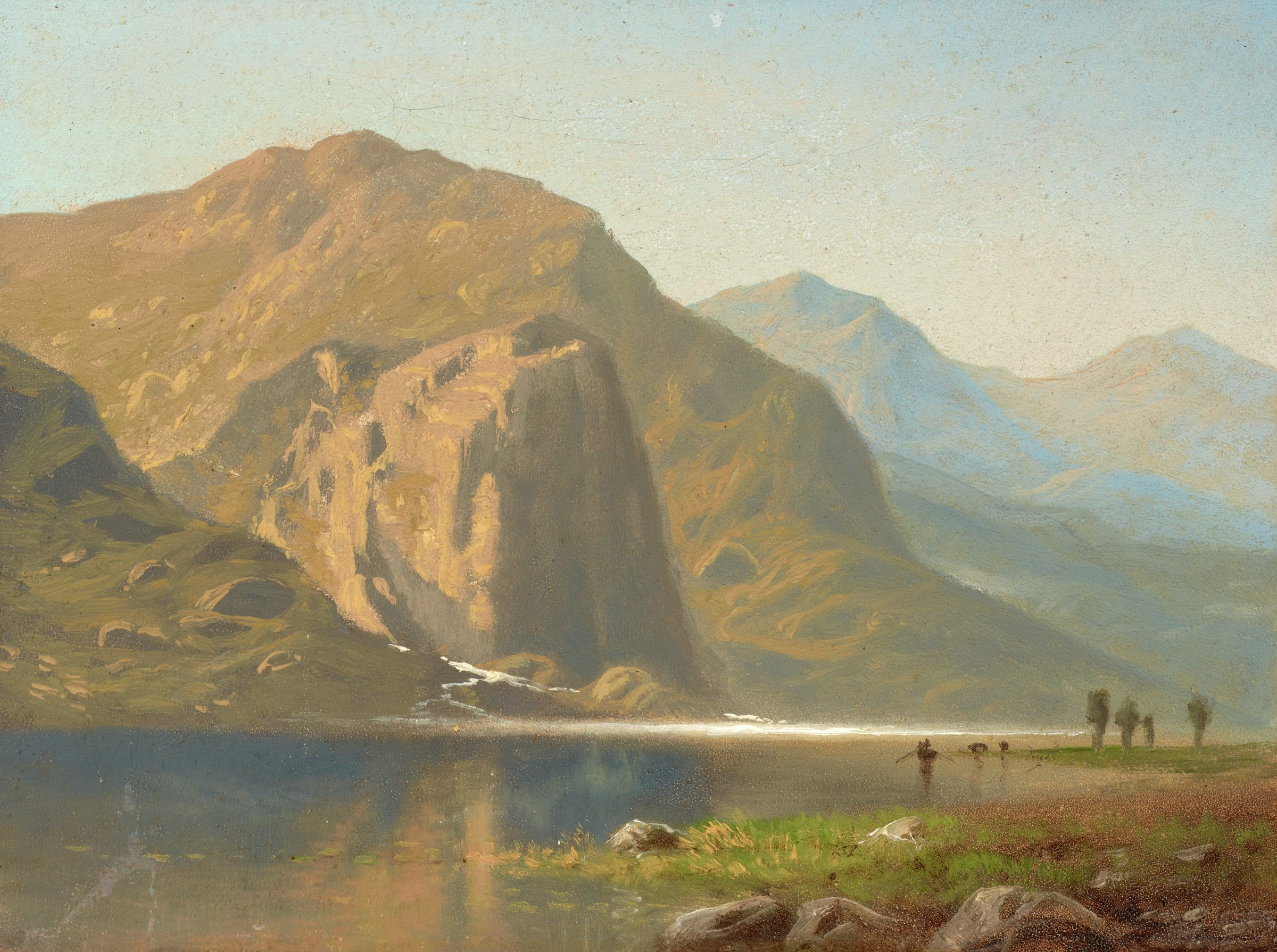 This small painting is a sketch of a mountainous landscape with a body of water in the foreground and middleground. In the lower right corner of the painting is a u-shaped coastline with scattered rocks and a few small trees in the distance. The body of water extends to the base of mountains that rise vertically from its shore. These mountains recede into the distance.