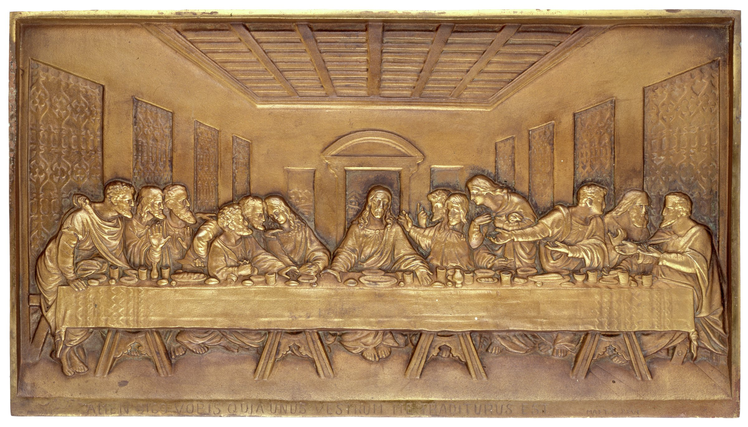 "Large rectangular plaque of cast iron with a gilded surface depicting the Last Supper after Leonardo da Vinci (1452-1519), self framed, with the Latin text below, ""AMEN DICO VOBIS QUIA UNUS VESTRUM ME TRADITURUS EST."" and ""MATT. C. XXVI."""