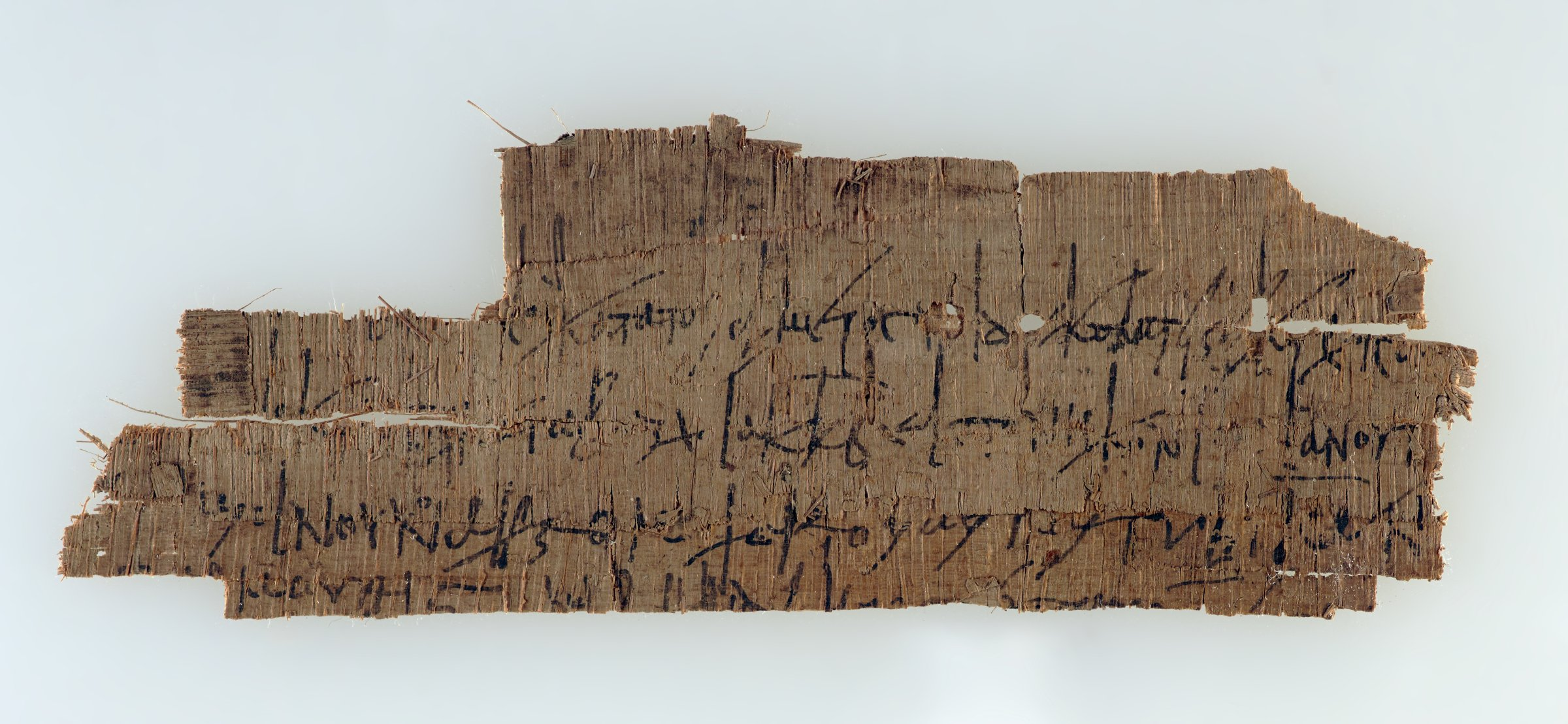 Papyrus fragment with Greek script. Fragment of a possible account of payments in solidi. Mentions wine, a tabularius, and days in different months. Remains of an account on the back.