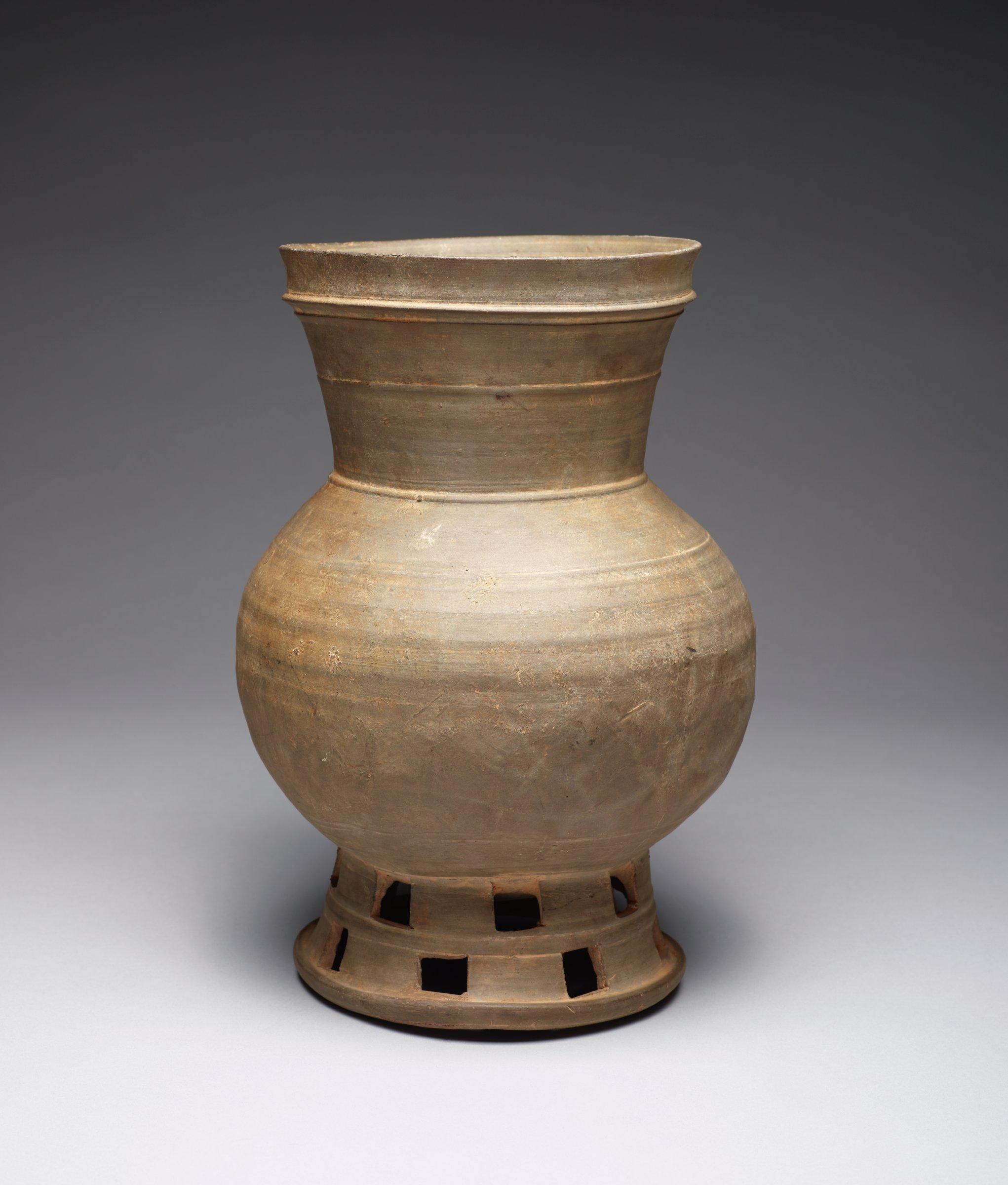 Banded Long-Neck Pierced Pedestal Jar. Resonstructed belly.
