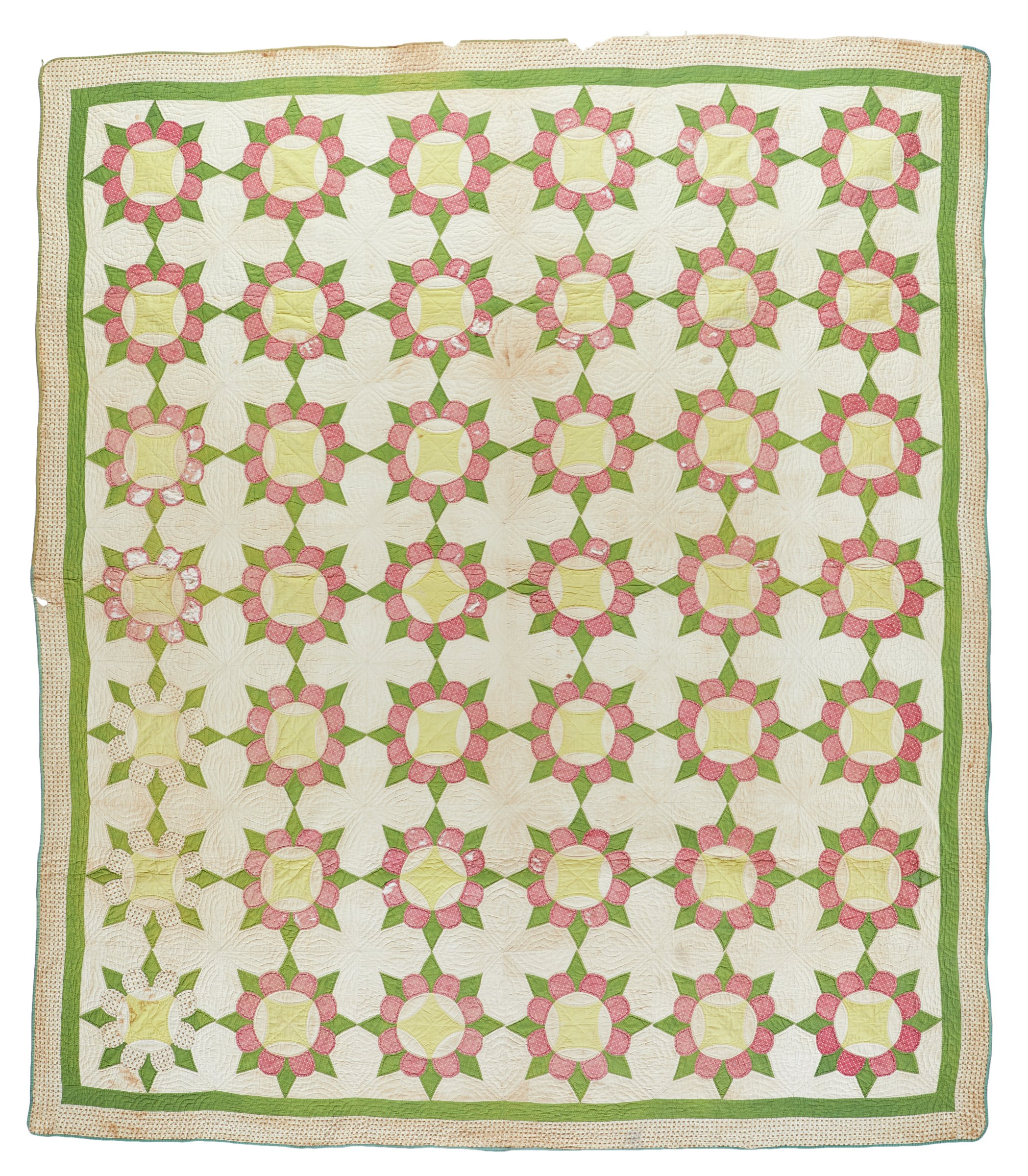 """Large hand-sewn quilt in the """"Caesar's Crown"""" pattern made with a plain cream-colored cotton backing edged in green with a border of tiny brown flowers on an ivory ground and an interior border in a green print, the top of the quilt with a cream-colored ground and a grid of red circles with green spikes and yellow reel centers that together form the image of a kind of crown, three of the circles of brown and cream printed fabric instead of red."""