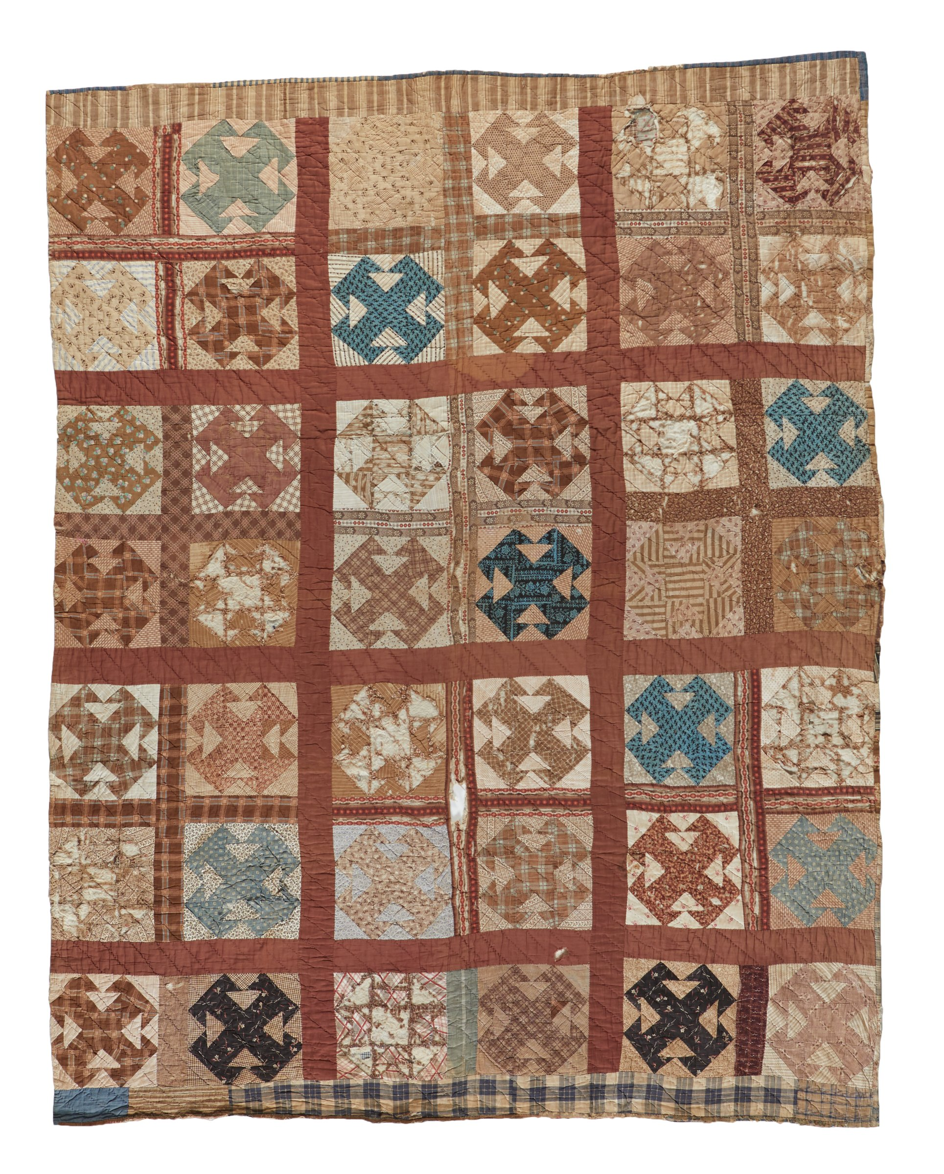 """Double sided quilt of old printed and plain woven cotton fabrics, on one side the """"Four Ts"""" pattern comprised of a grid of squares each with a pattern of four Ts that connect at the base of each letter, in floral and geometric-patterned fabrics along with plaids and leafy designs; the other side in the """"Sampler"""" pattern with a grid of squares each with a different pattern inside in seersucker, gingham and stripes in shades of blues, reds and browns, along with polka dots, paisley and lots of plaids, the edging partially missing."""