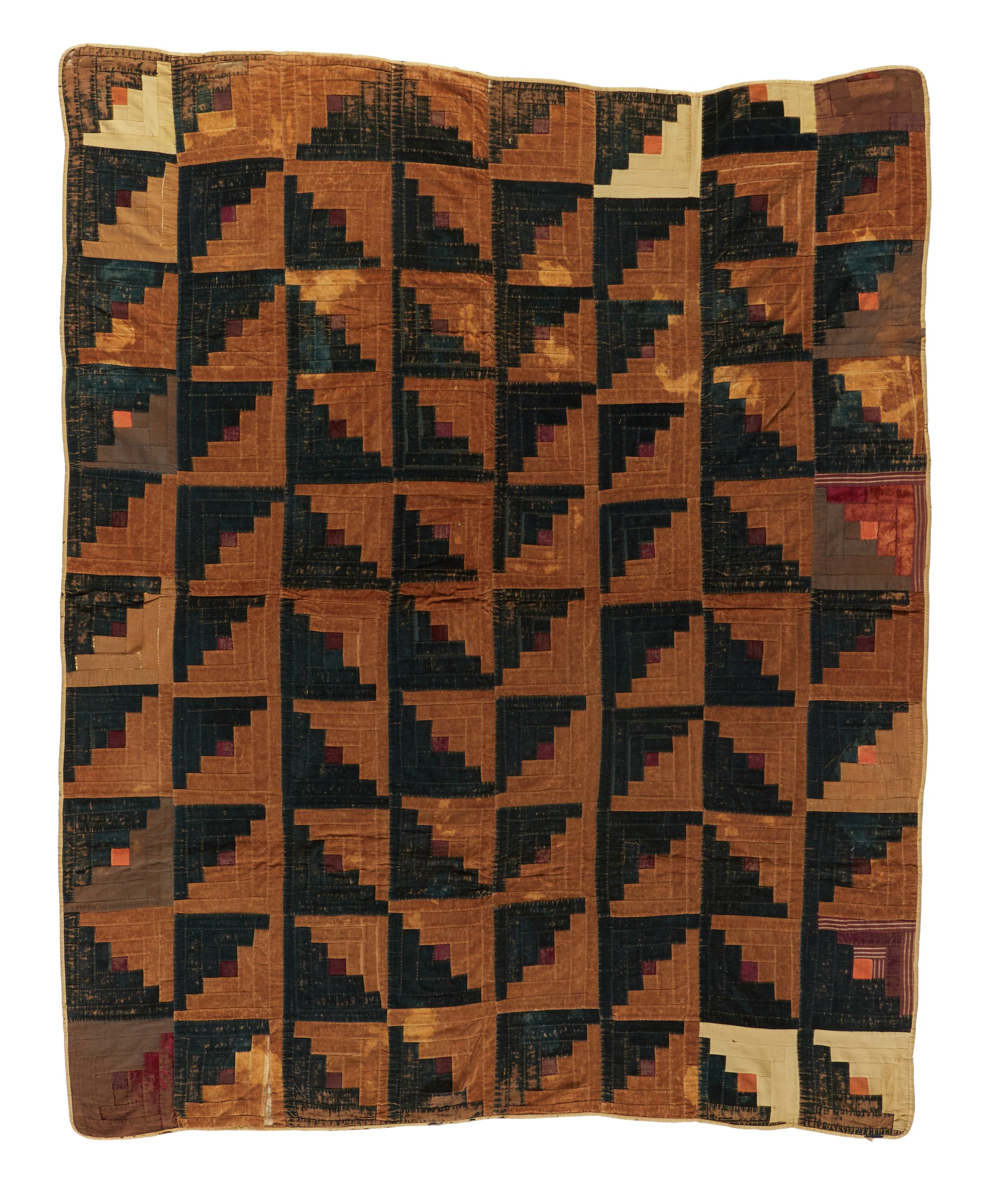 Large, hand-sewn rectangular quilt of cotton velvet, cotton and wool, in the Log Cabin pattern comprised of a grid of squares of crushed brown velvet strips and opposing green strips with a single maroon square in the center, with beige edging, the backing in a printed cotton floral fabric in shades of brown and red, repairs have been made throughout with orange and rust-colored velvet and brown cotton.