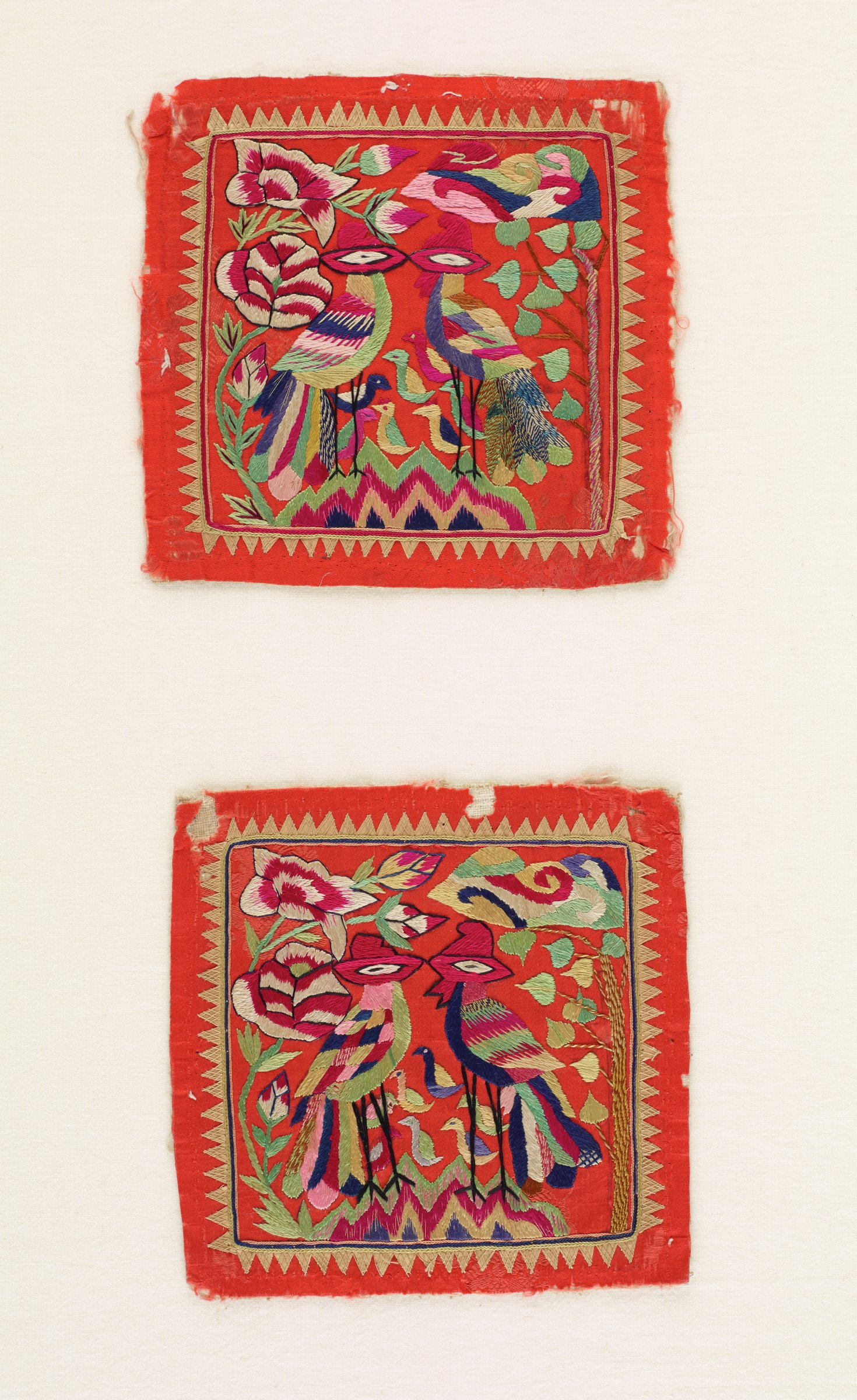 Pair of square pillow ends with embroidered designs of love birds with baby chicks on orange background