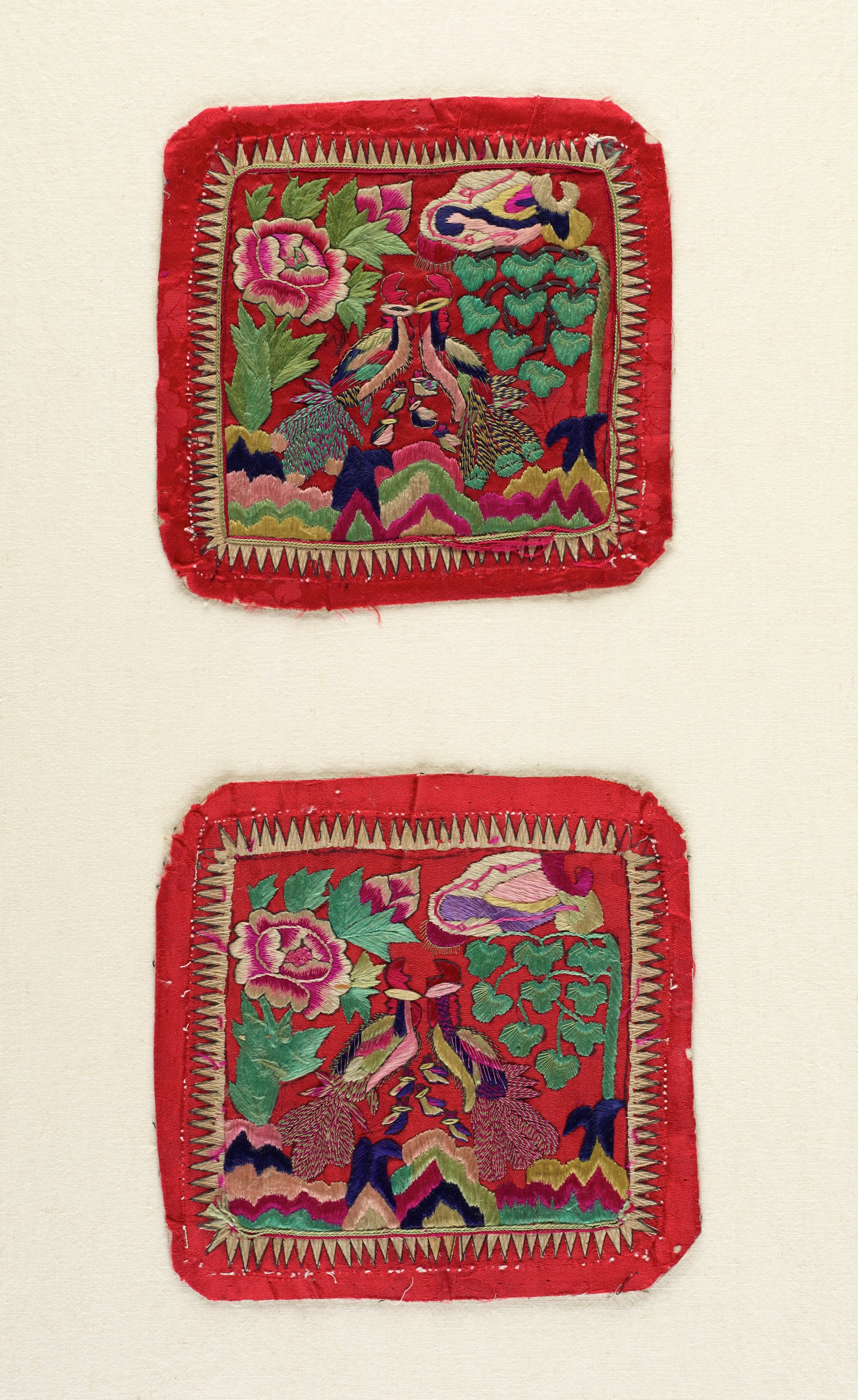 Pair of square pillow ends with embroidered designs of love birds with baby chicks on red background