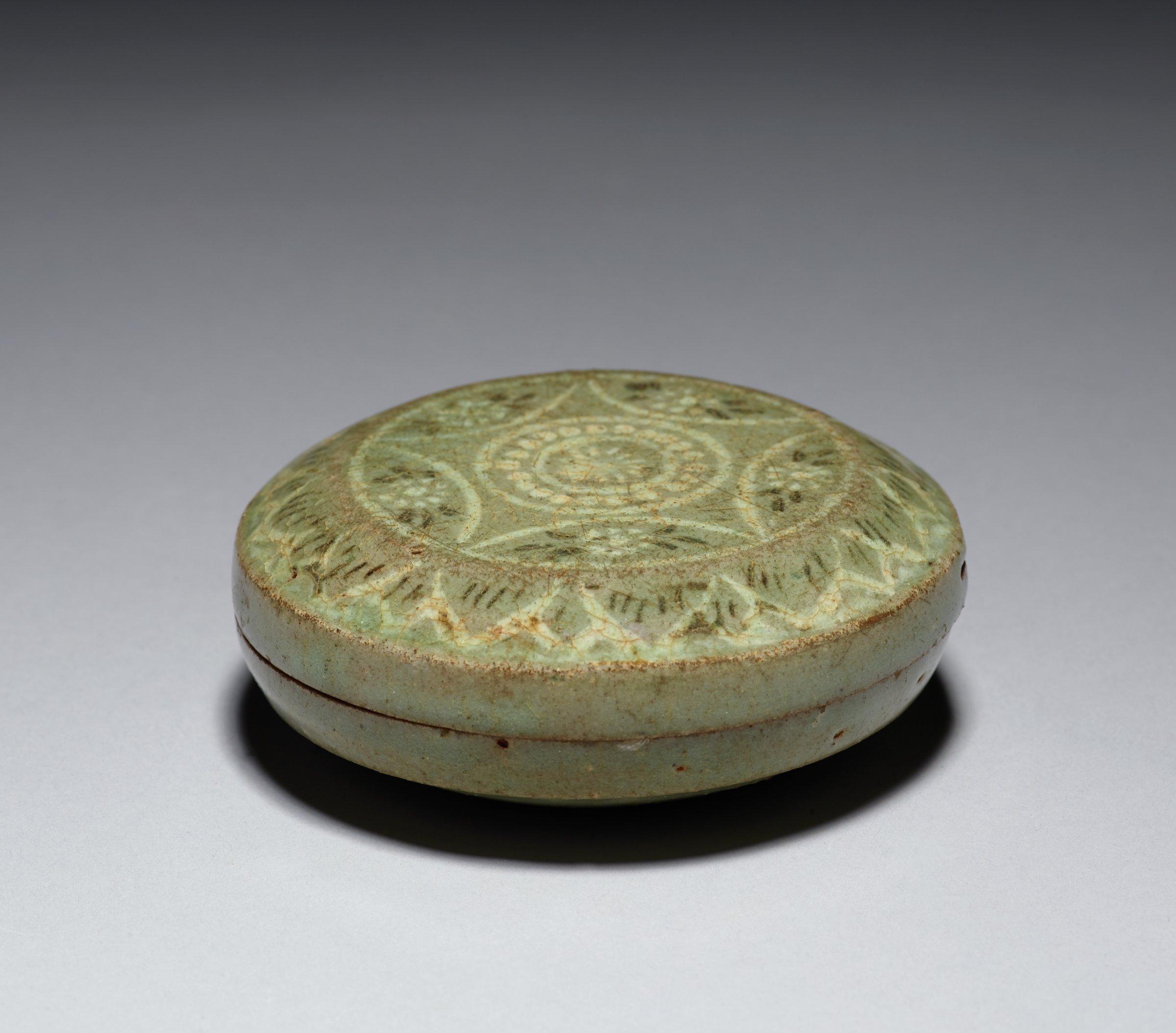 Celadon with inlaid slip decoration