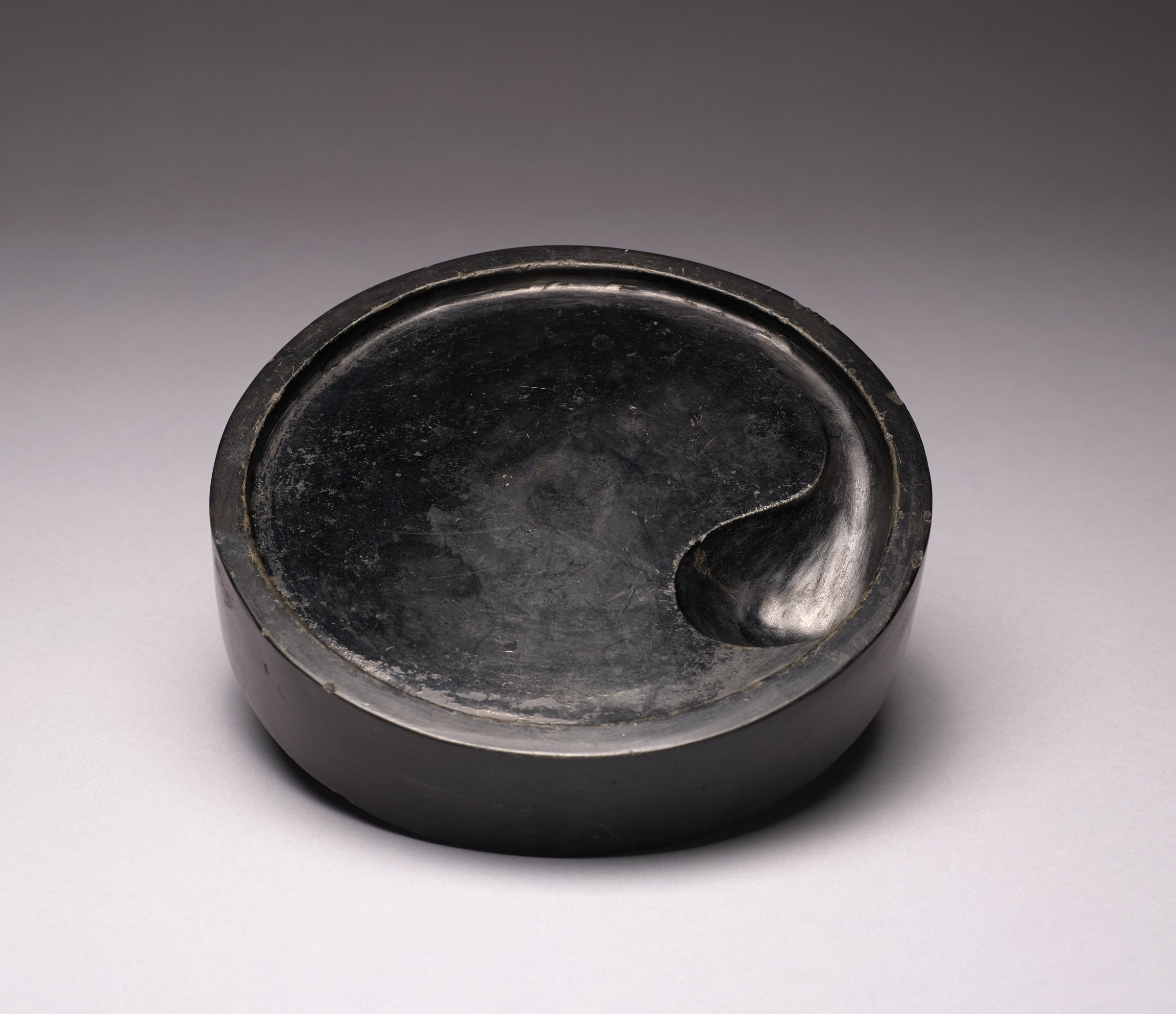 A scholar's ink stone in the shape of the Yin/Yang