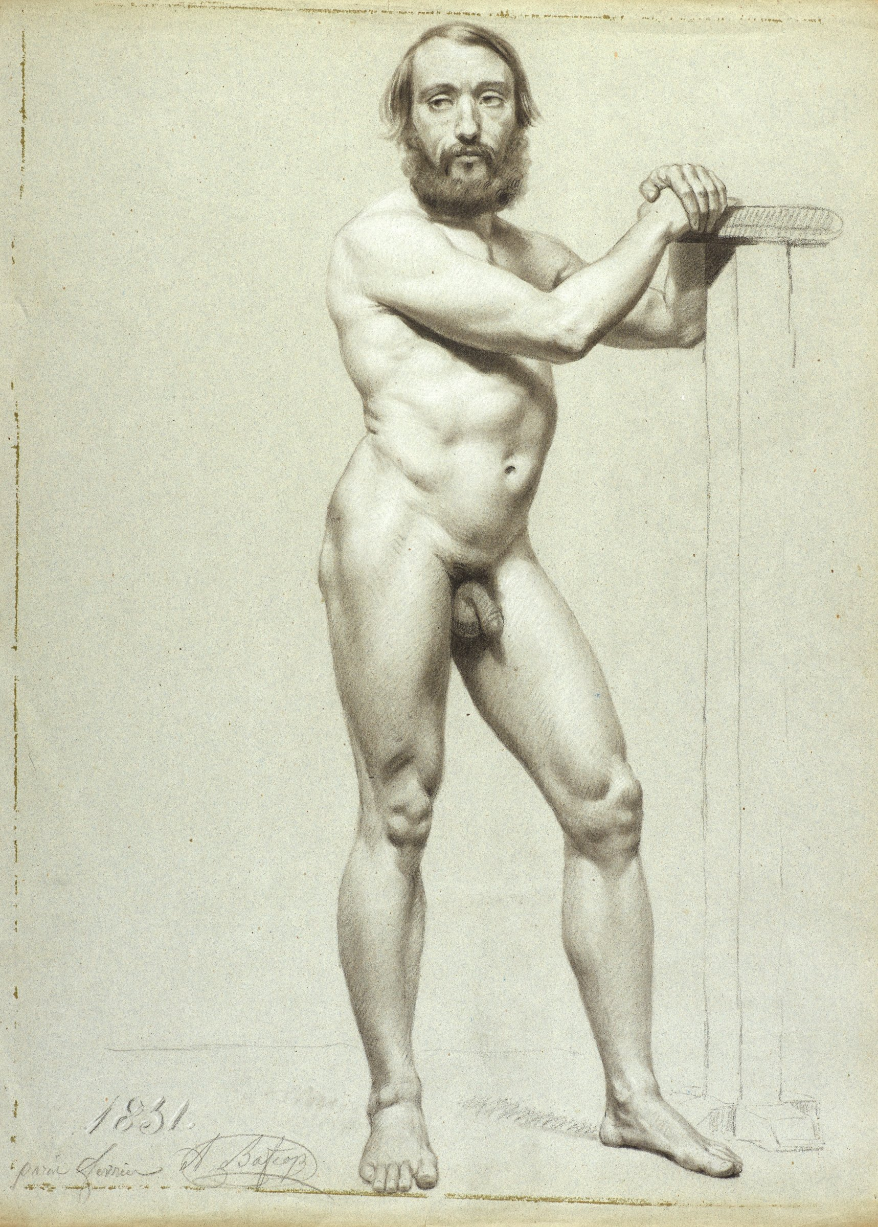A nude male stands facing forward with his body angled to the right. His hands are clasped and resting on a post.