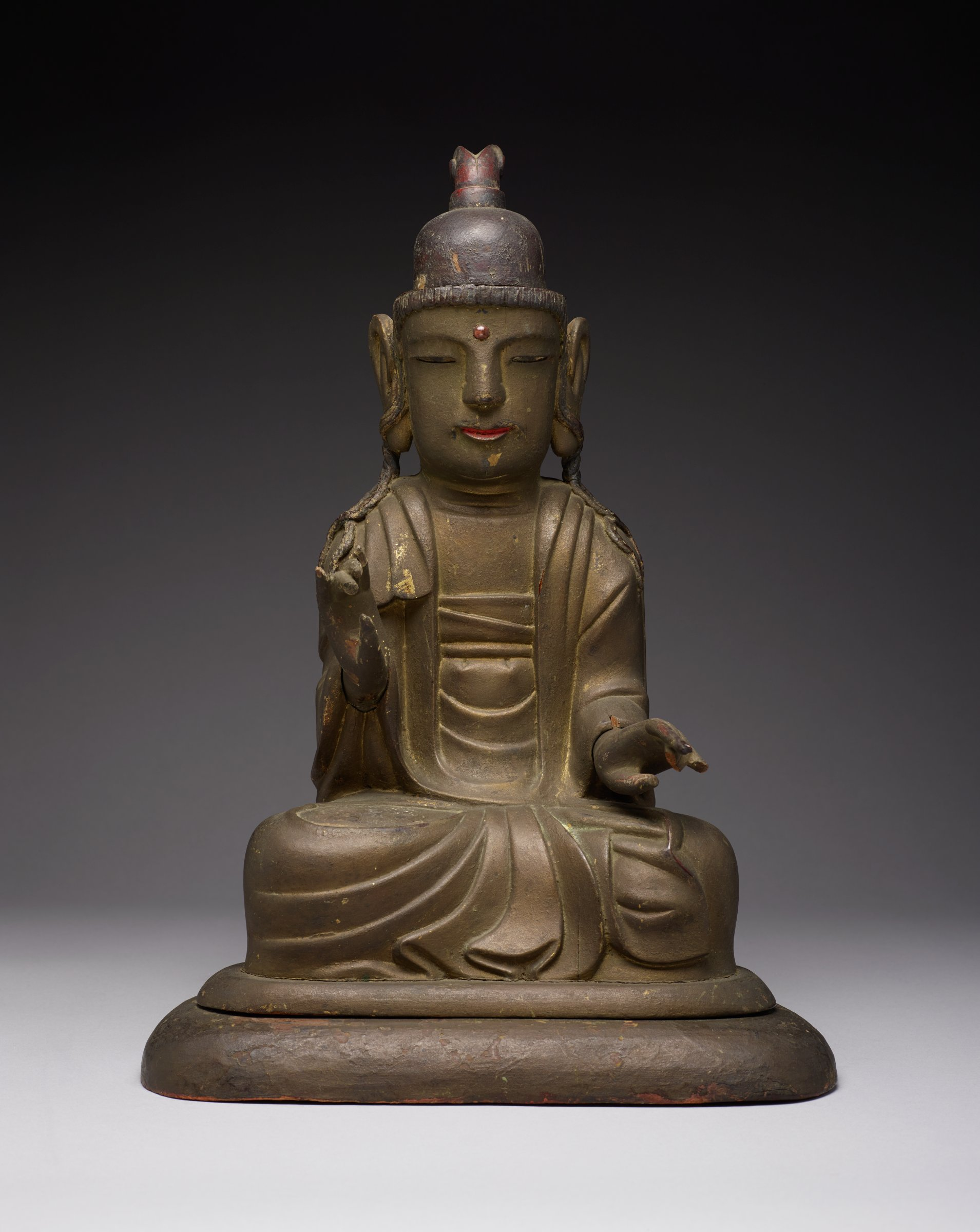 """As is typical statue's hands are removable. Its base is also removable. Consecration contents appear in tact (visible through hold in sealing base. Hand-made metal nails seal the base possibly also with bamboo nails.Statue alone: H: 15.75, W: 10 D: 8"""" Base alonge: H:1"""" x W: 12"""" D: 8.5"""""""
