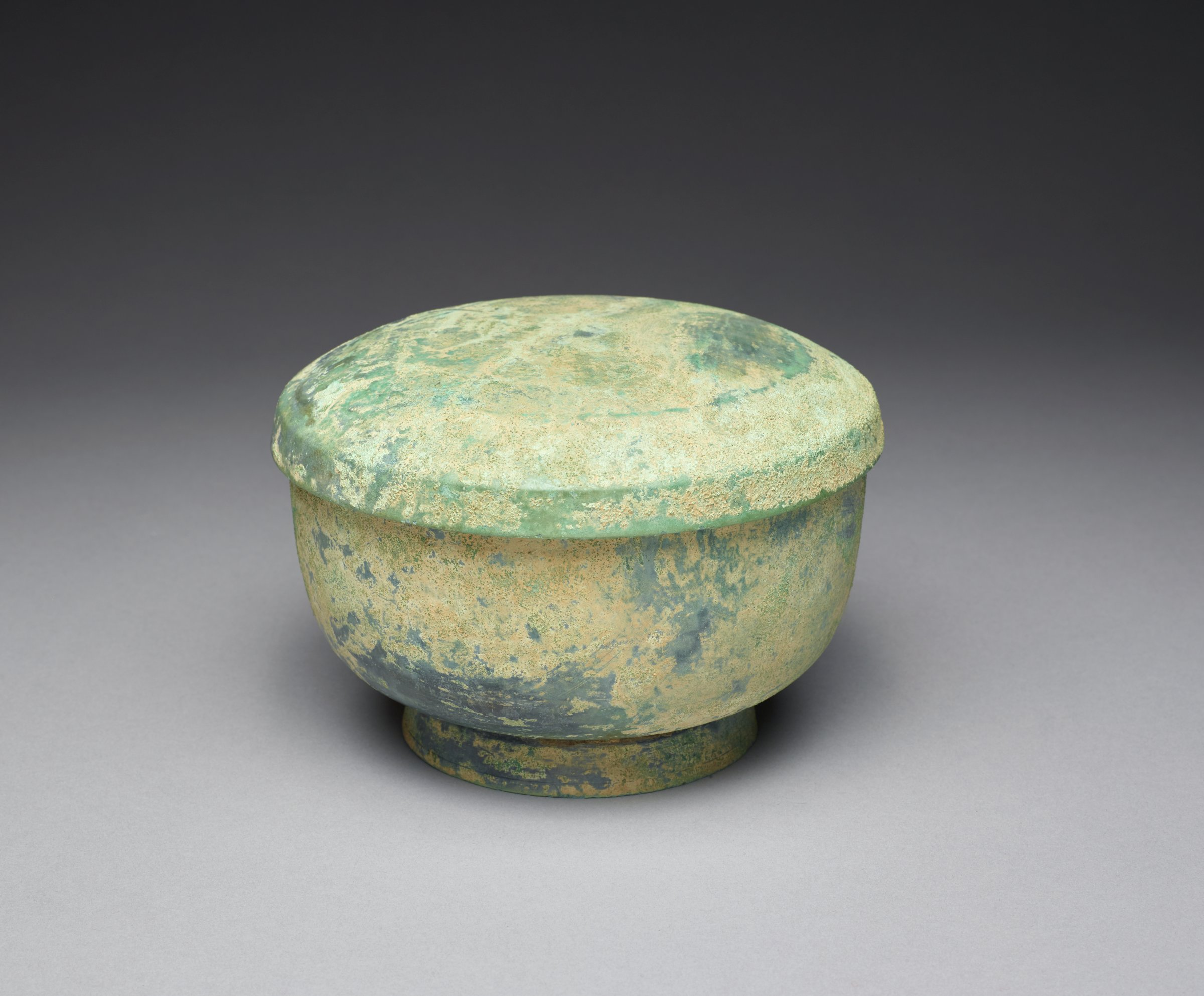 """Foot is riveted to bowl, lid separate, a good marriage.Lidded Footed BowlBowl: H: 4"""" DIA: 6.5""""; Lid: H: 1.25"""" DIA: 6 5/8"""""""