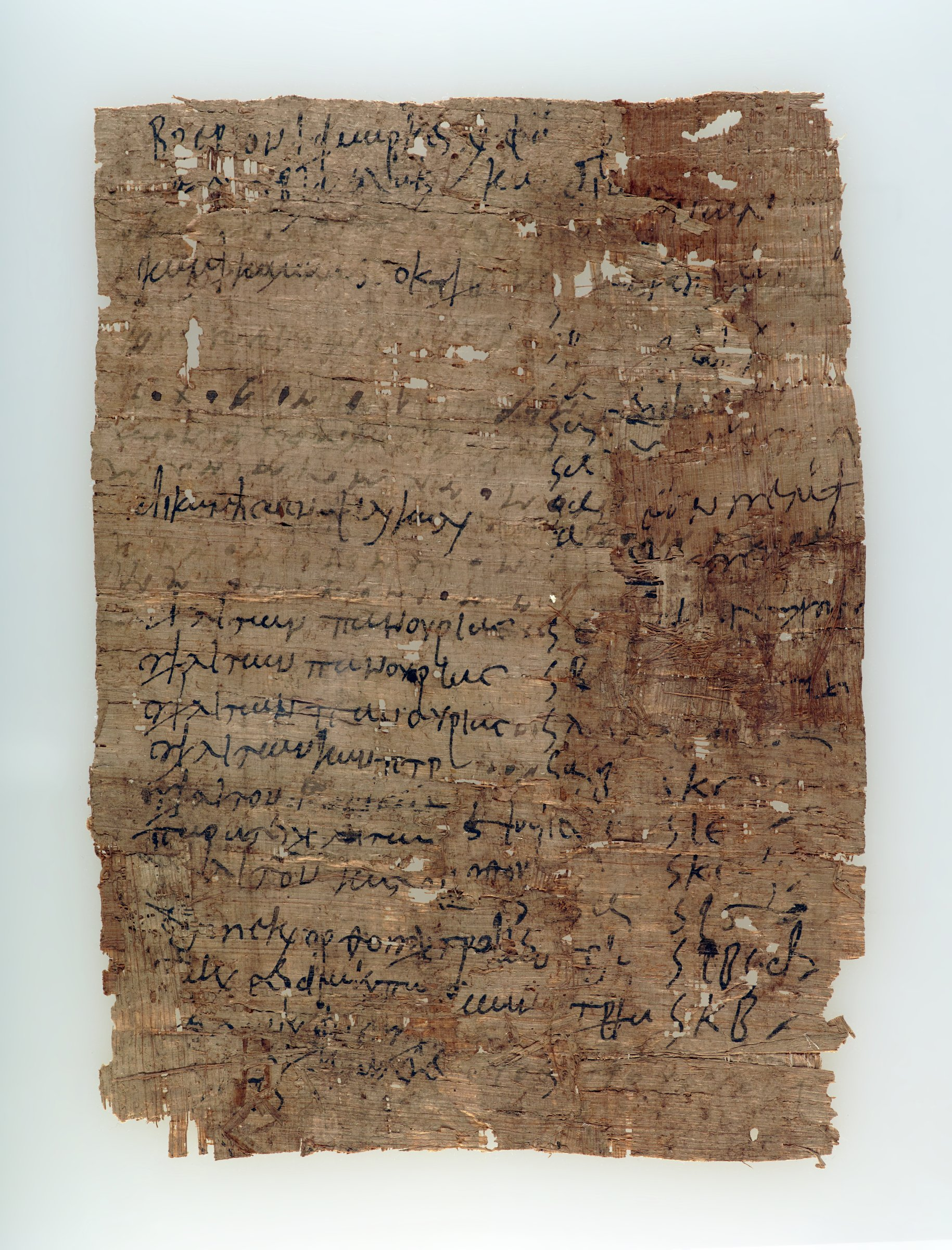 Papyrus fragment with Greek script. The text is an inventory of garments with payments in money.
