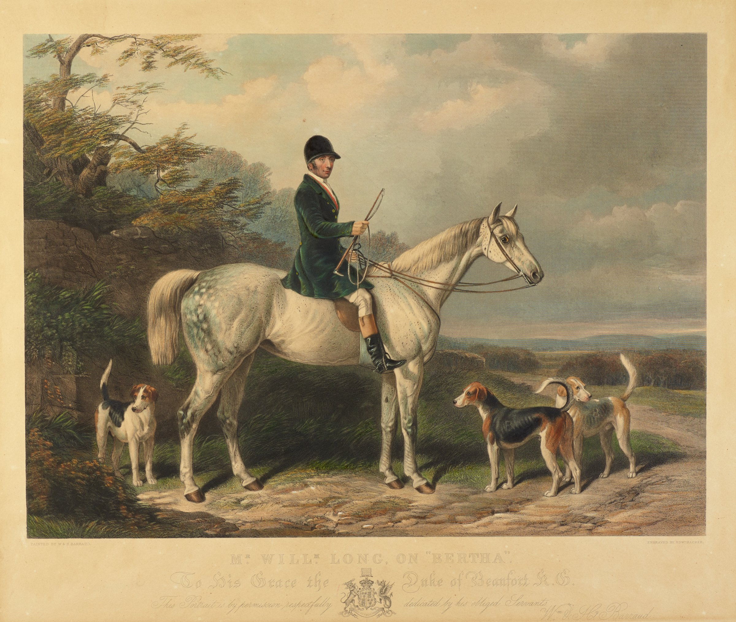 A man wearing a black helmet, a long blue coat, and riding boots sits on a white speckled horse. They stand on a path within a lush landscape. Three dogs standing alert surround the horse.