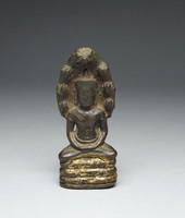 Buddha seated on the Naga Muchalina, worn from worship.