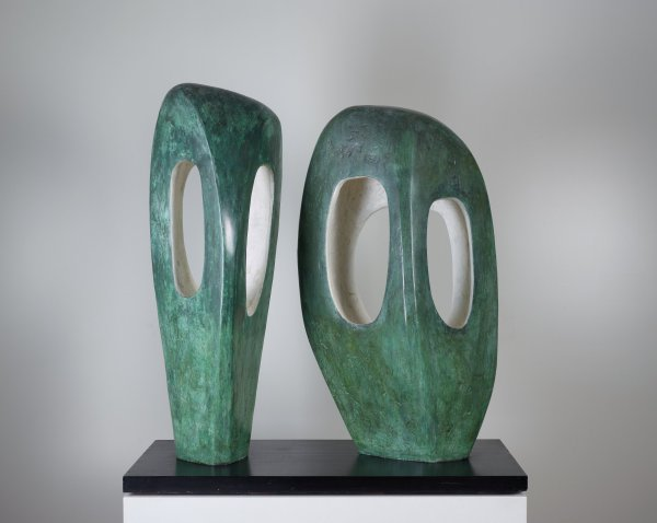 Abstract sculpture in bronze on a slate base