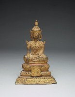 A seated crowned Buddha in the bhumisparsa-mudra on a trapezoidal throne with ornametns and adornments typcial of Rattanakosin Period