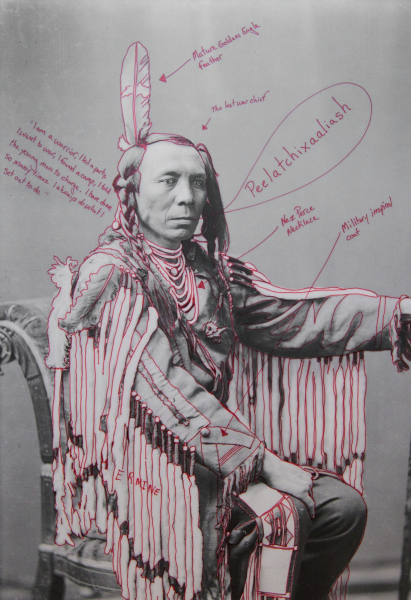 Artist-manipulated digitally reproduced photograph by C.M. (Charles Milton) Bell; subject is Peelatchixaaliash / Old Crow (Raven) seated, partial figure, three-quarter view, one arm up. Elements of regalia outlined in red, and text annotations in red radiate from figure.