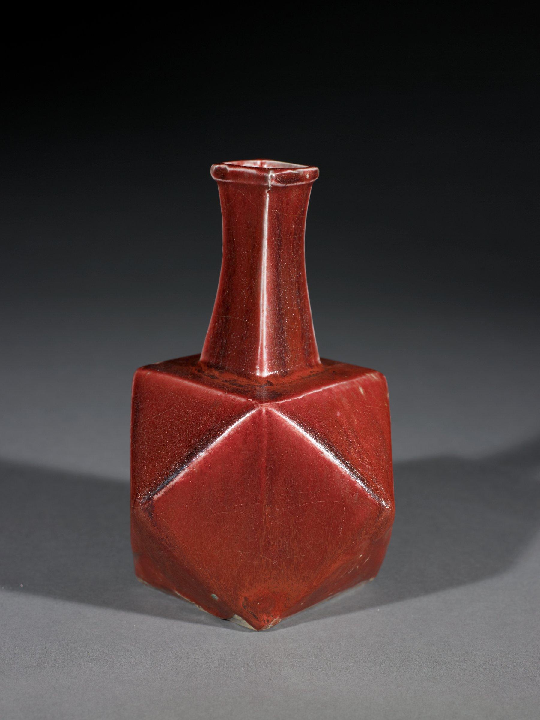 An unusual hexagonal shaped bottle in underglaze copper red