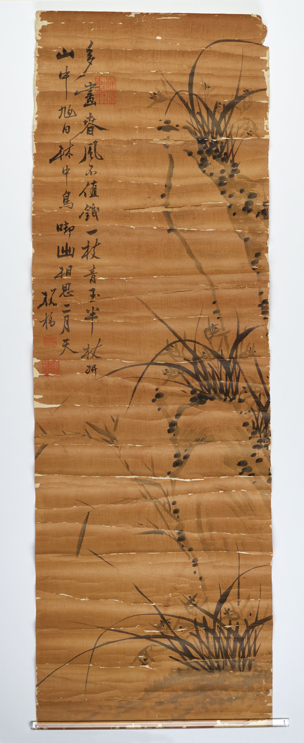 Unmounted Ink Painting of Cybidium among Rocks with Calligraphy. Three square red seals.Poor condition mounted on paper