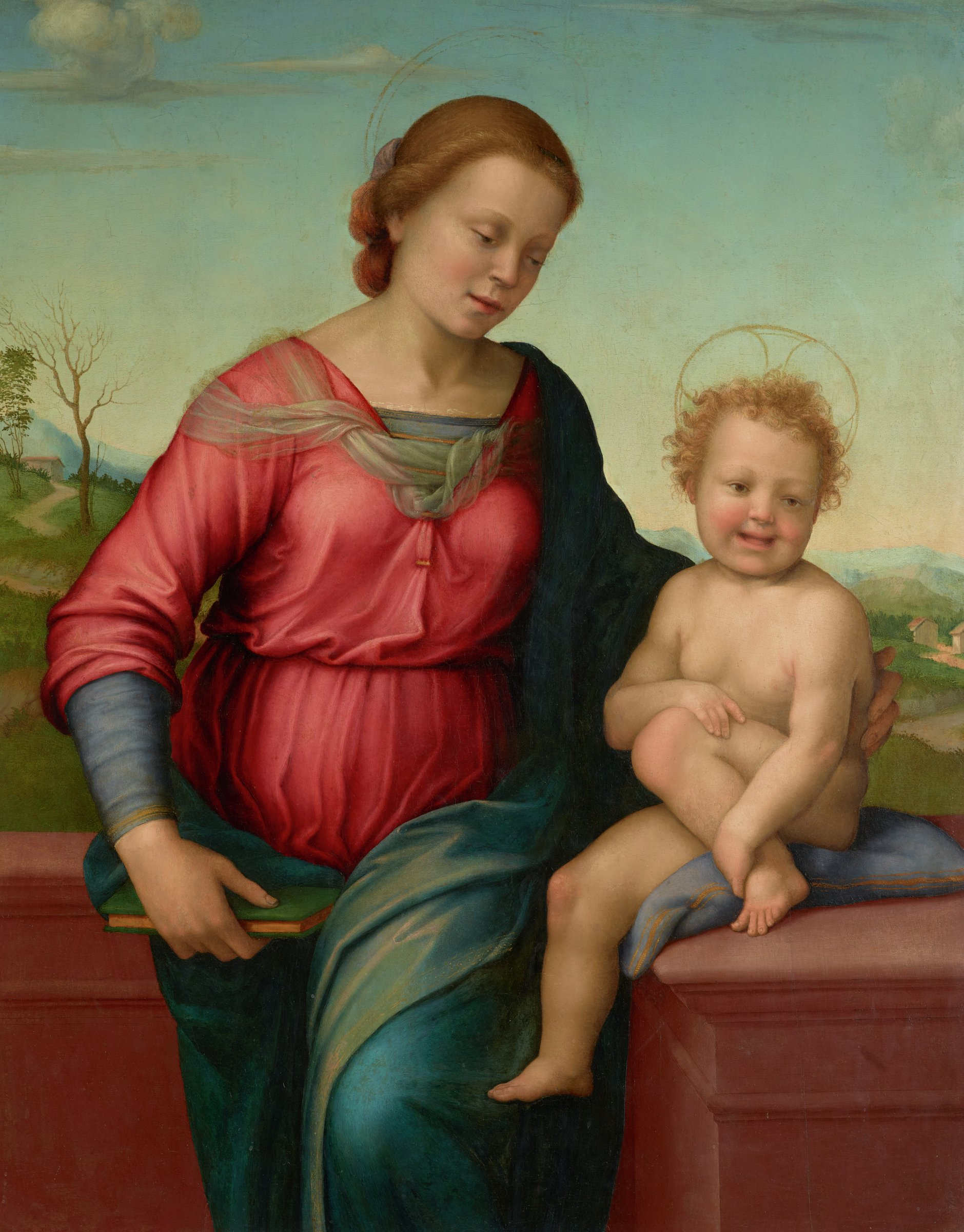 The Madonna stands in front of a low wall with hills and cottages behind her. She holds a book with one hand and with the other supports the back of the Christ Child who is seated on the wall. The Child smiles happily and looks out at the viewer.