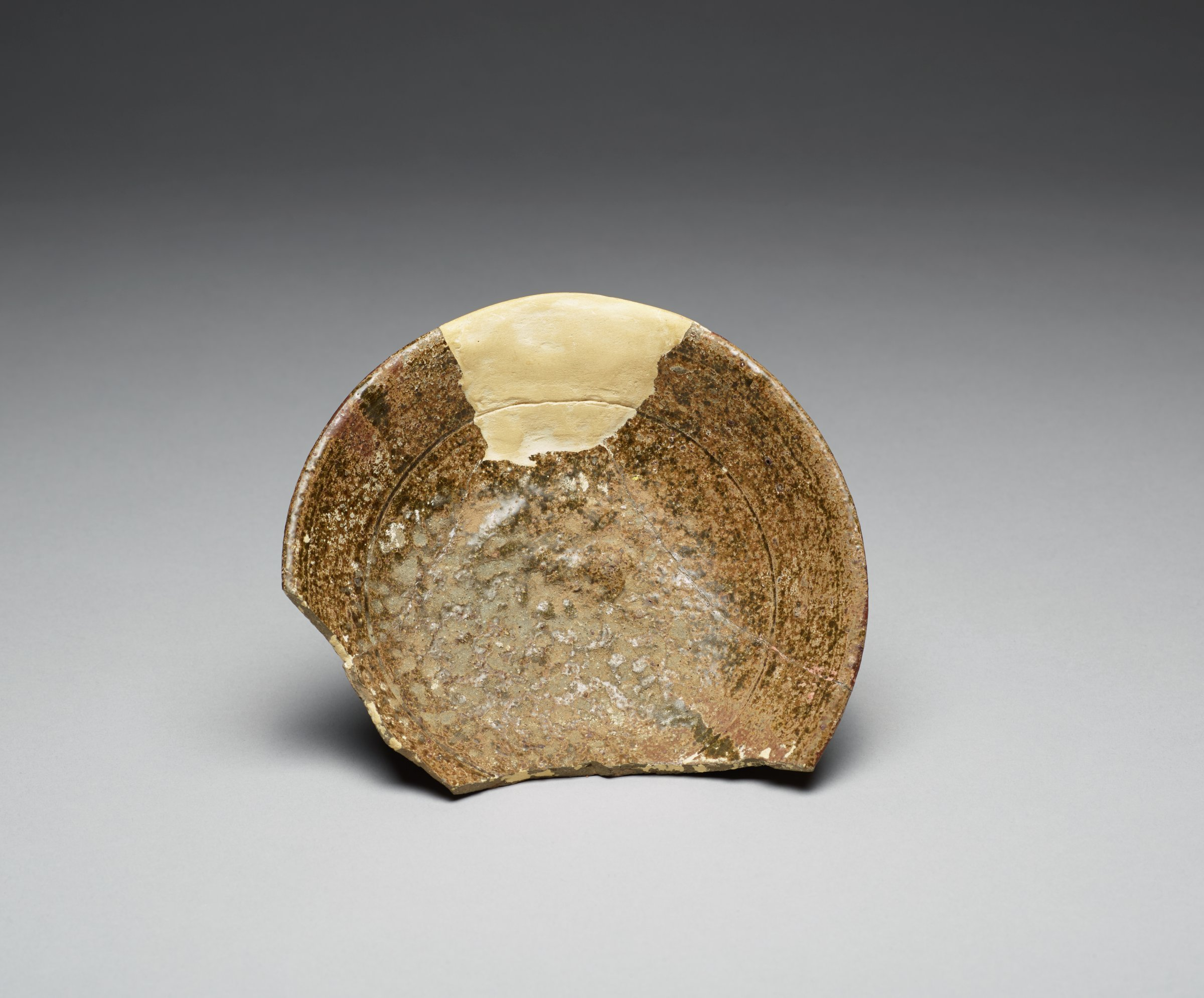 Footed Bowl Fragment with Brown Glaze