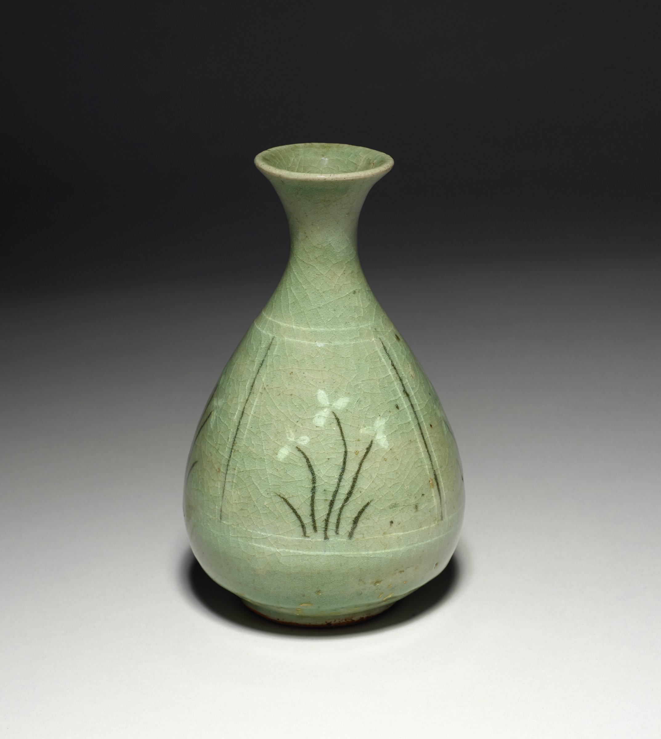 Celadon stoneware pear-shaped vase with short trumpet neck of meshema type.  Body inlaid with five panels of flowery grasses in white and brown slip